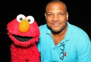 Elmo, Kevin Clash | Photo Credits: Frederick M. Brown/Getty Images