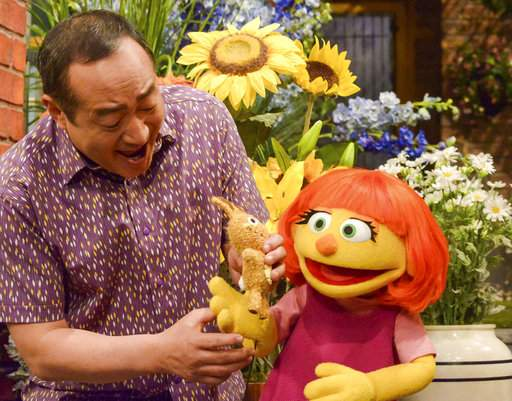 """This image released by Sesame Workshop shows Julia, a new autistic Muppet character debuting on the 47th season of """"Sesame Street."""""""