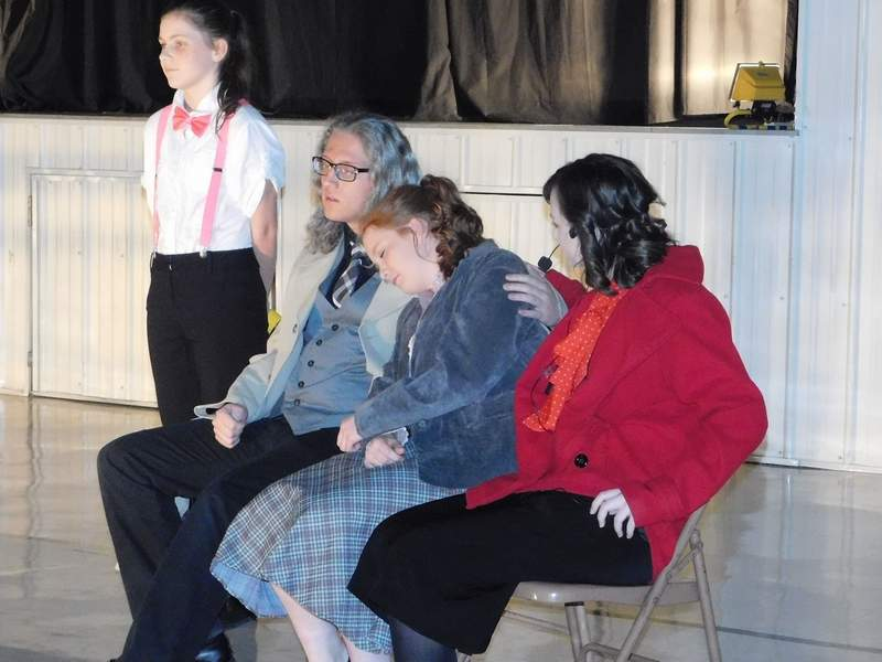Director Kim Ward and her Thompsonville students transformed the auditorium of Community of Christ Church into the set for the production of 'Annie Jr.' last weekend, including this scene from the song 'Let's Go to the Movies.'