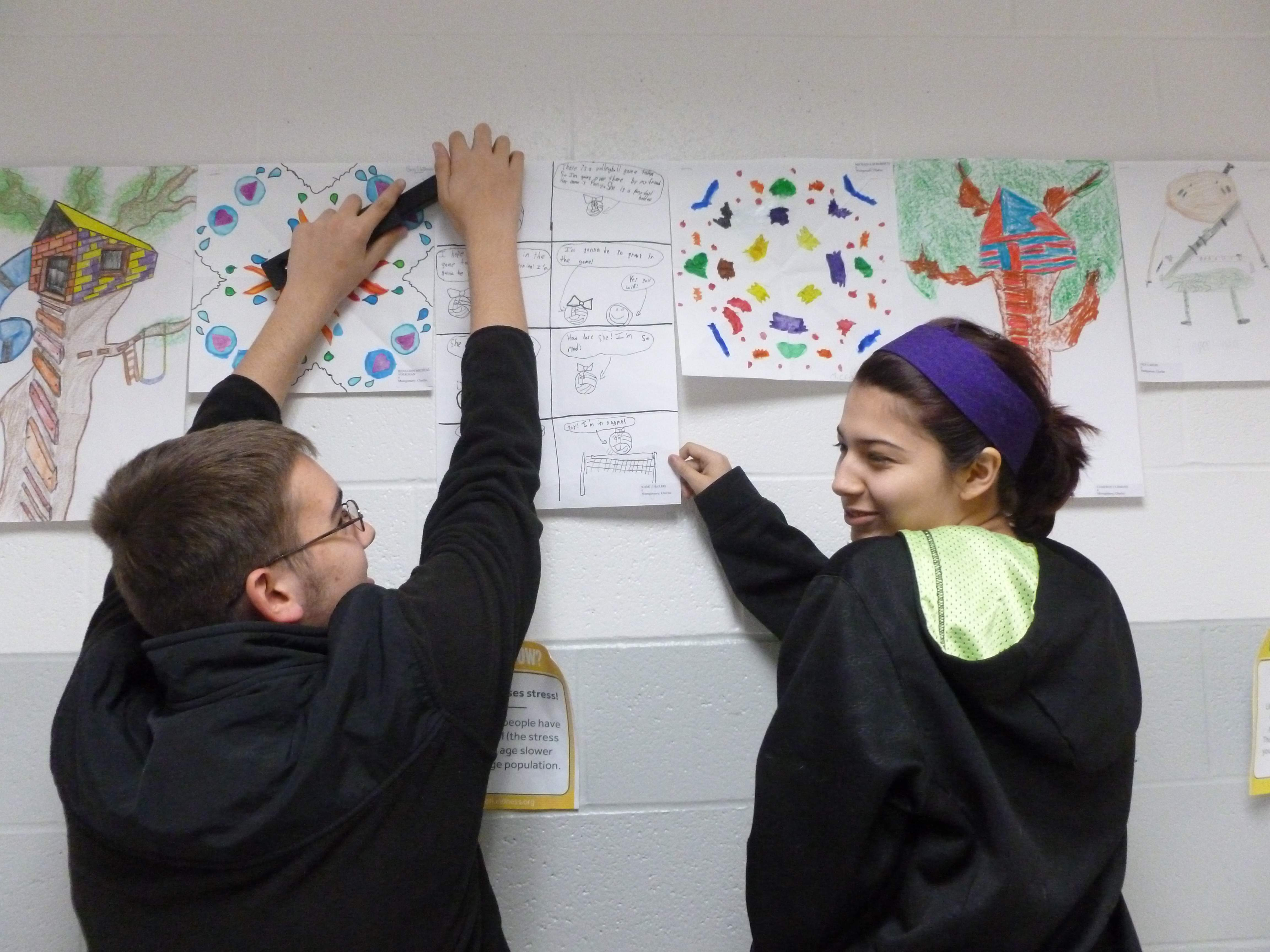 Students at Du Quoin Middle School are hanging art around the school in preparation for the upcoming All-Student Art Show, which will be held from 5:30 to 7 p.m. Thursday, April 20 at the school. The evening will include the exhibition of more than 1,000 pieces of student-produced art, as well as face-painting, DJ Christian Feltmeyer, refreshments, a photo booth and coloring page stations. The free event will be hosted by middle school art teacher Candace Campanella and elementary/high school art teacher Andrea Collins.