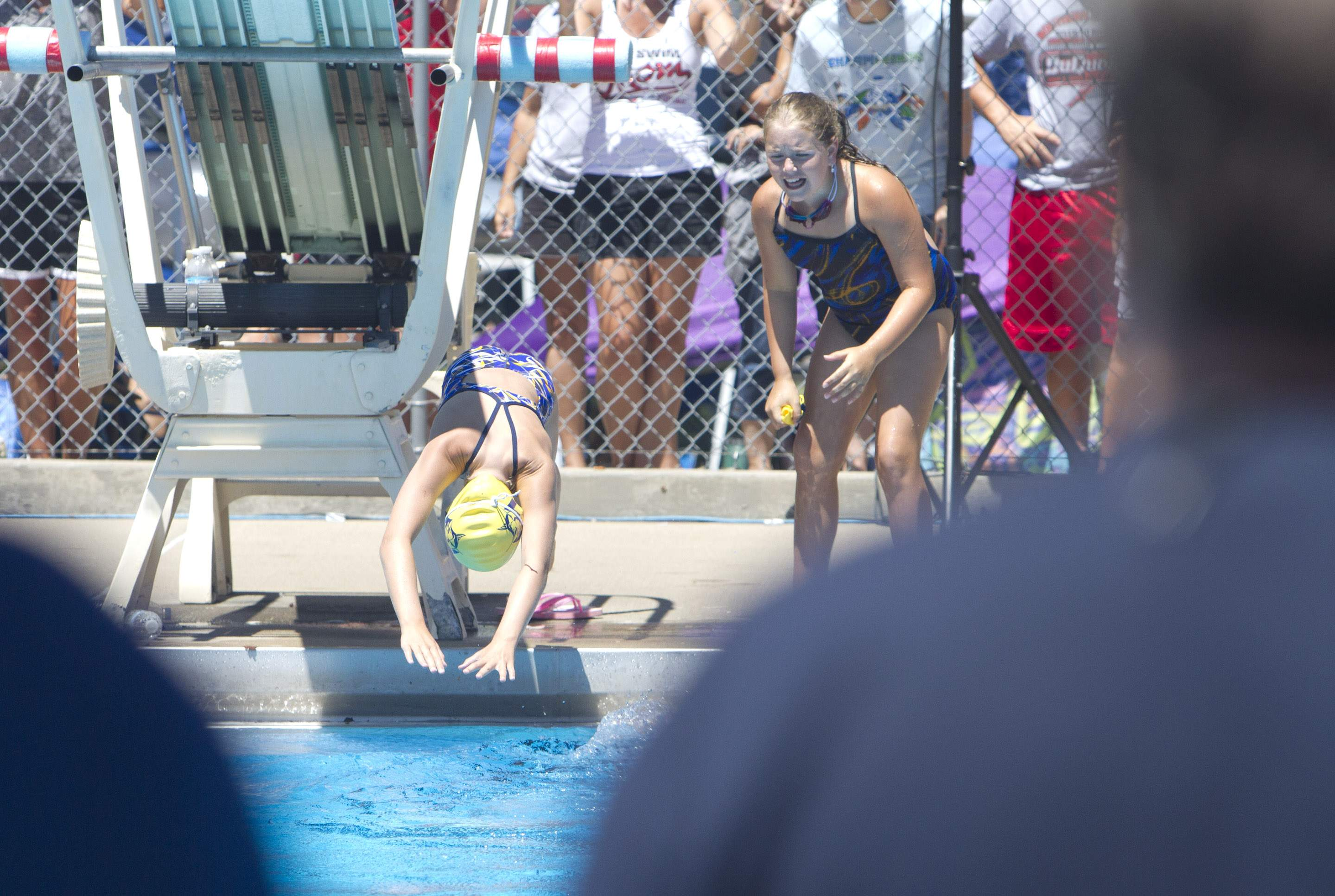 Marion's Alexa McCuan yells encouragement as teammate Riece Utley dives in the water during the 9-10 freestyle relay Saturday. Marion won the relay, which also included Lacey Edwards and Abi Rees.