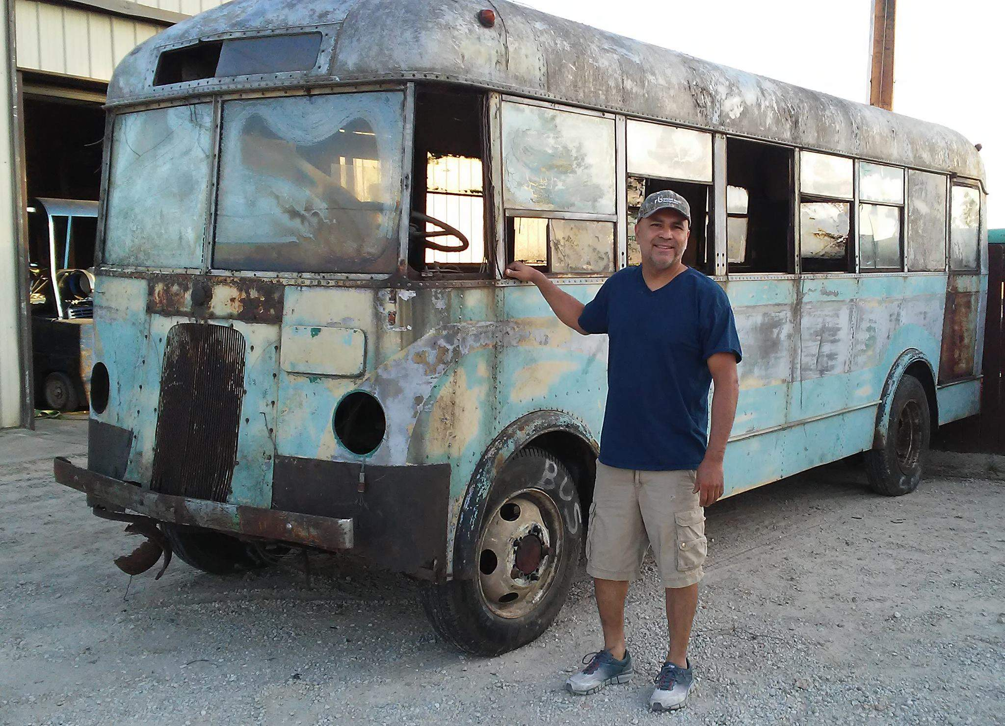"High Ridge (Mo.) resident James Gebert is pictured with his 1936 Yellow Coach bus that he is restoring. Gebert noted that portions of the name ""Chester Coach Lines Inc."" became visible after power washing the bus's exterior."