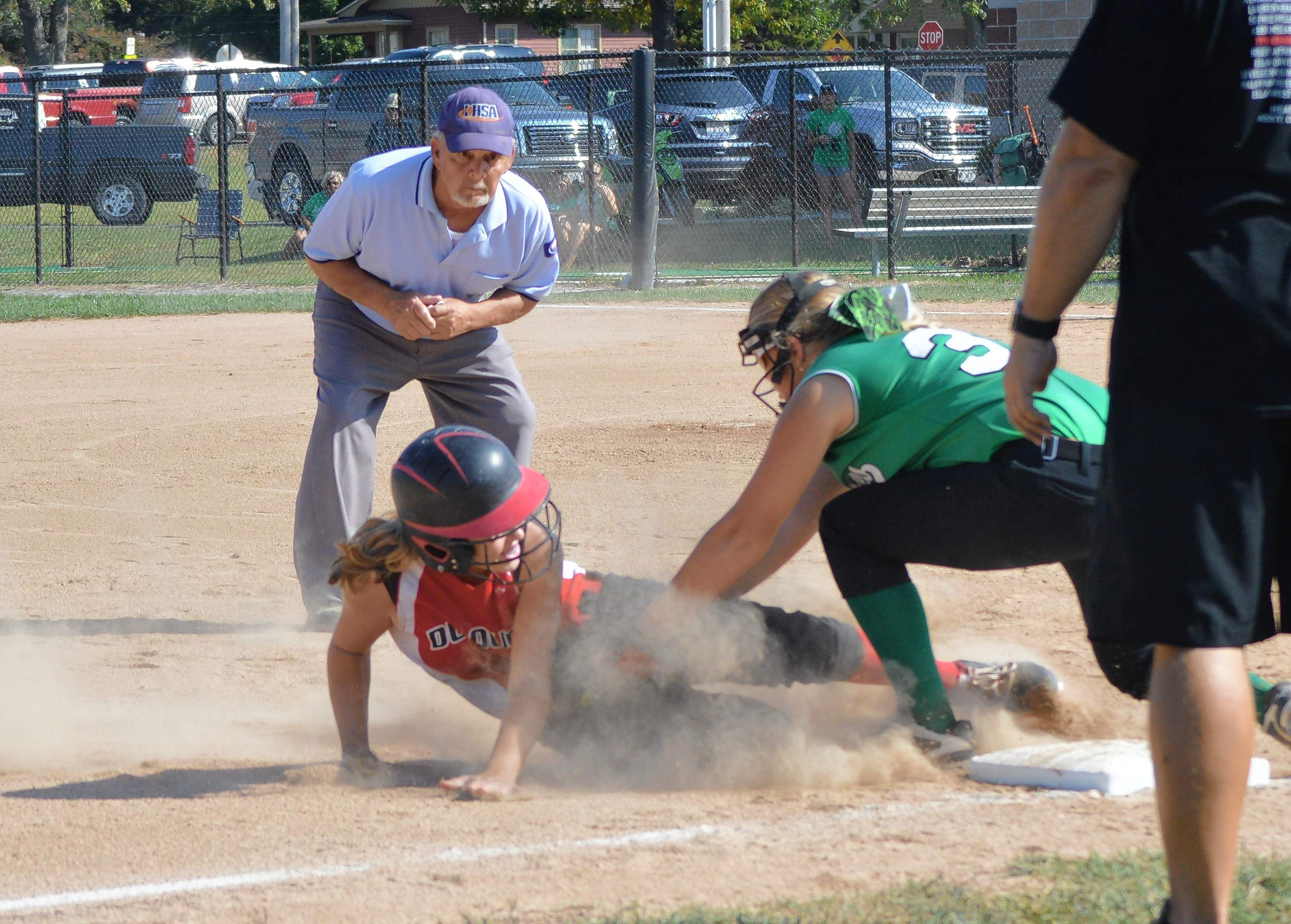 Warriors' Abbi Mocaby slides into third base for an RBI triple in the first inning of the regional championship game against Hamilton County hosted in Du Quoin.