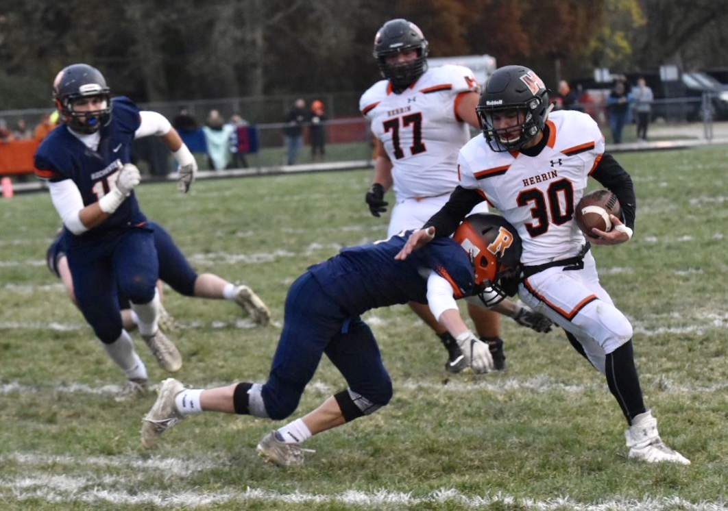 Herrin's Jackson Yates dodged Rochester defenders during the first half of play Saturday.
