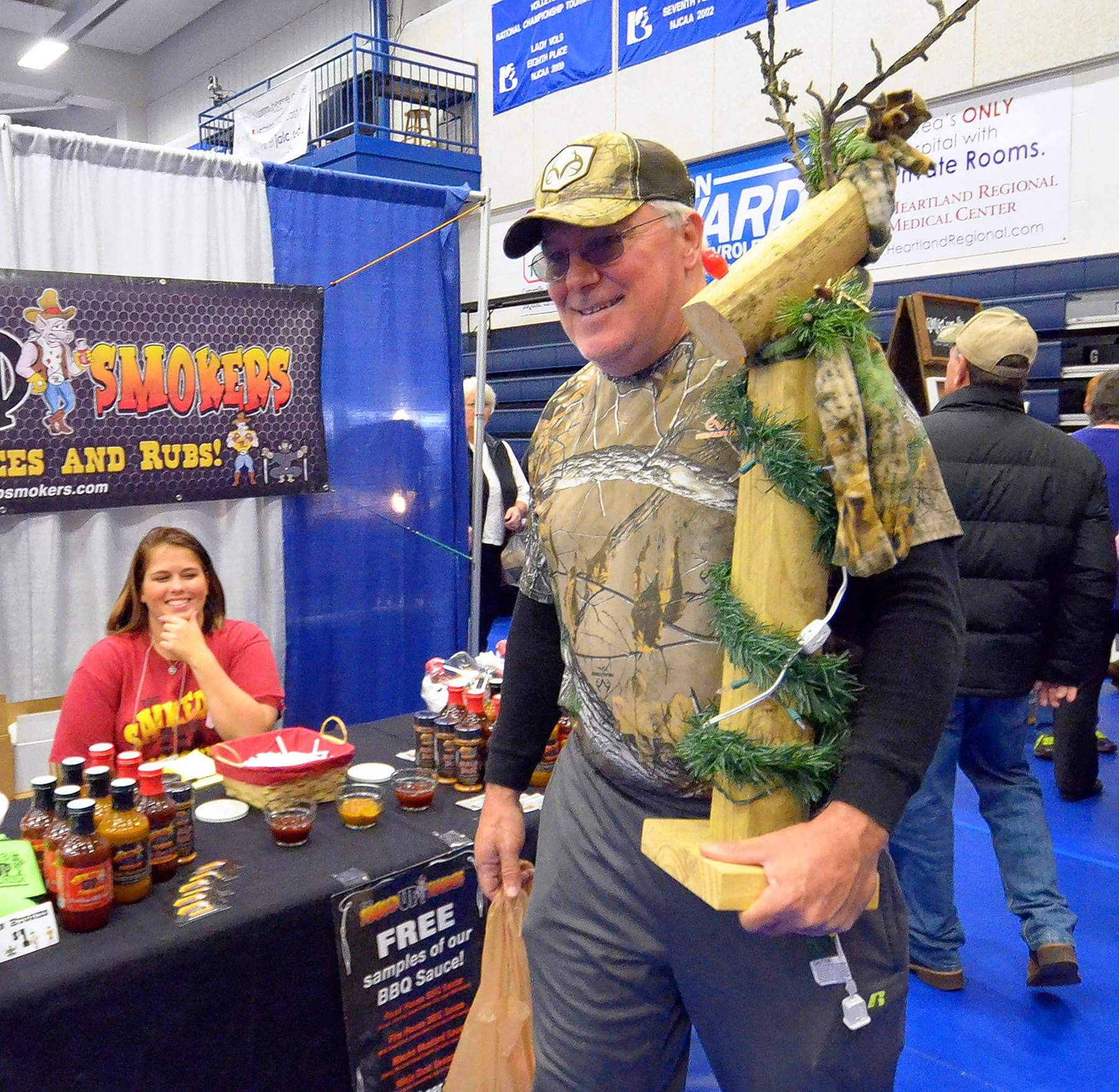 "Harrisburg resident Tom Pattee carries out a lighted wooden reindeer that he purchased for $20. He called it a bargain, and said he was going to return to the booth and buy two more. A first time visitor to the highly popular show, Pattee said, ""This is a lot more fun than I thought it would be."""