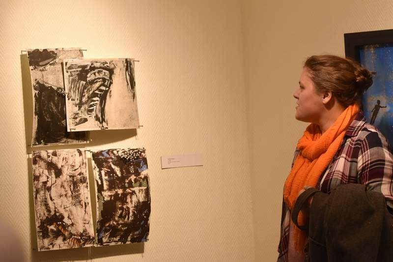 Camille Ticheur, an SIUC bachelor of fine arts student, talks about her work on display in the art gallery of Southeastern Illinois College Thursday Night. SIC opened a show with the work of SIUC Celine A. Chu Scholarship Award winners.