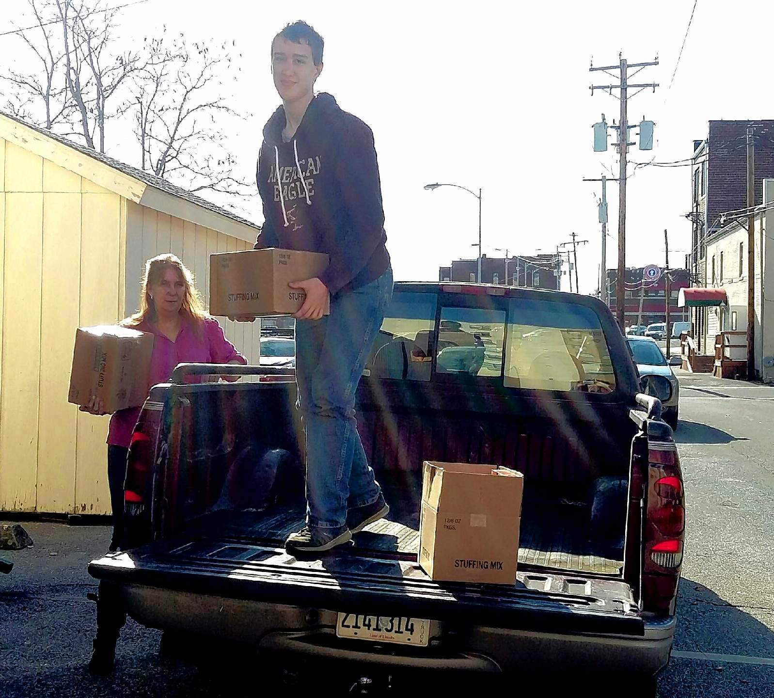 Marta Prudent photoAssistant Director for the Marion Ministerial Alliance, Teresa Morris, and William Bonroe, standing in truck, unload supplies for the food pantry Wednesday.