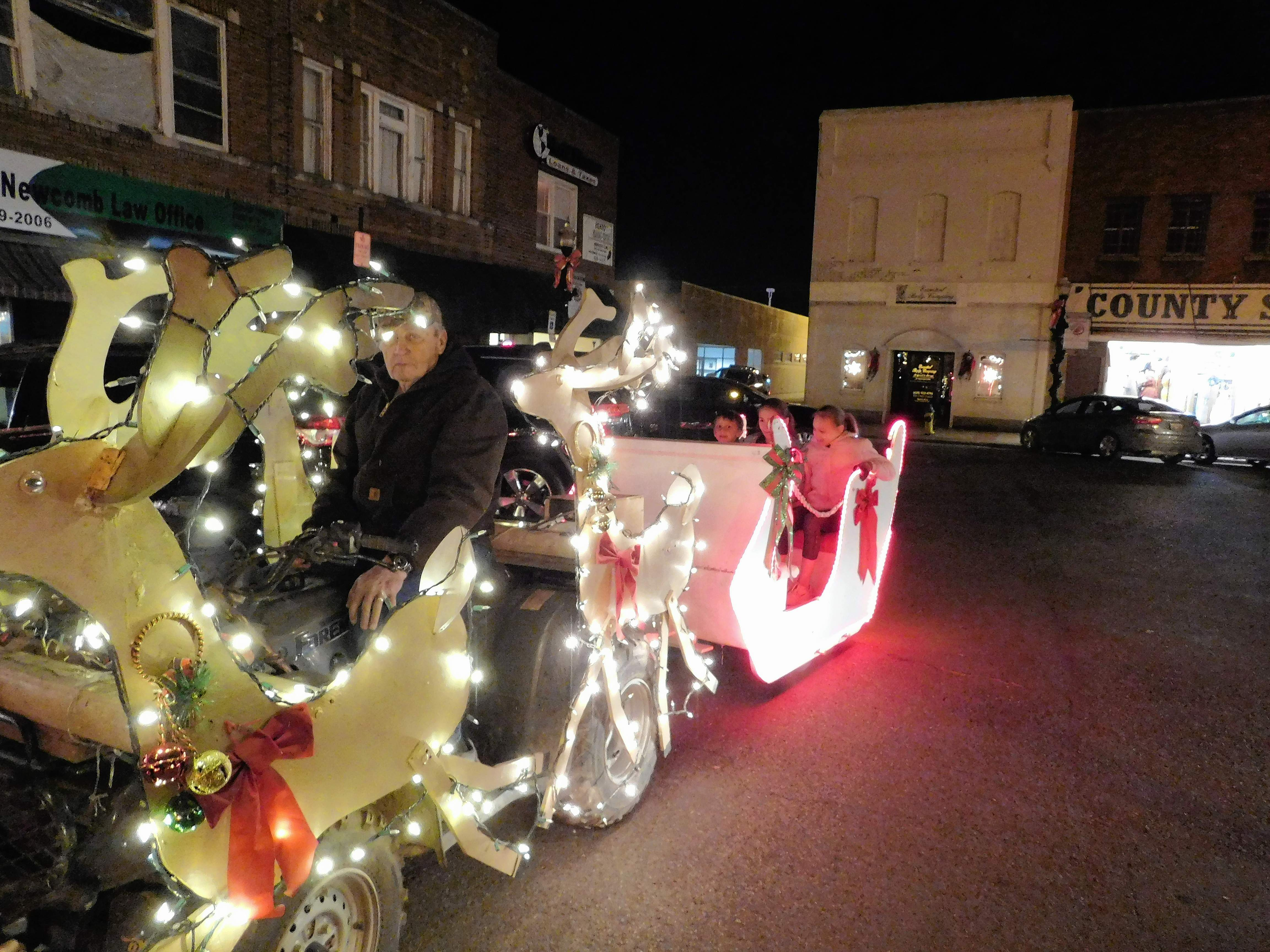 "Kenny Richardson and his ""sleigh"" were a hit with guests at the 2017 Festival of Lights in Benton last Friday.  Richardson fitted the lighted sleigh around an ATV to join in the festivities, even giving free rides to those waiting on the arrival of Santa."