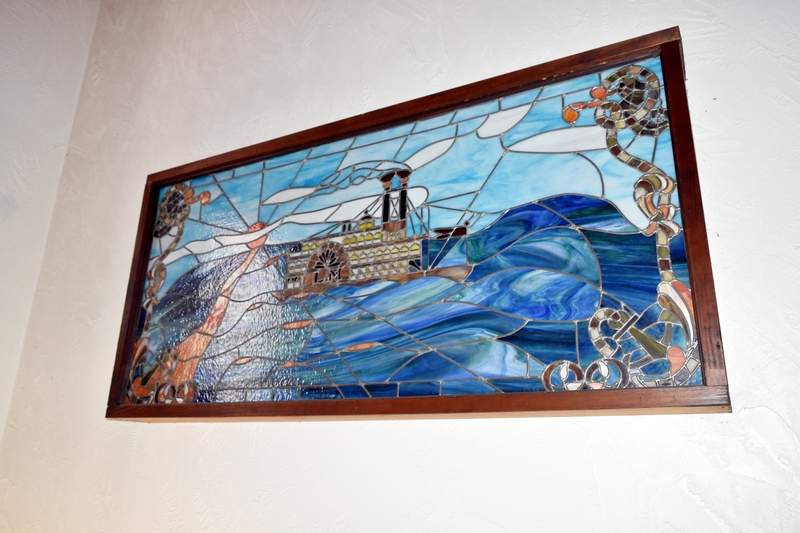 "This stained glass steamboat painting was made by former Landmark co-owner Clifford ""Doc"" Wright sometime during the 1980s."
