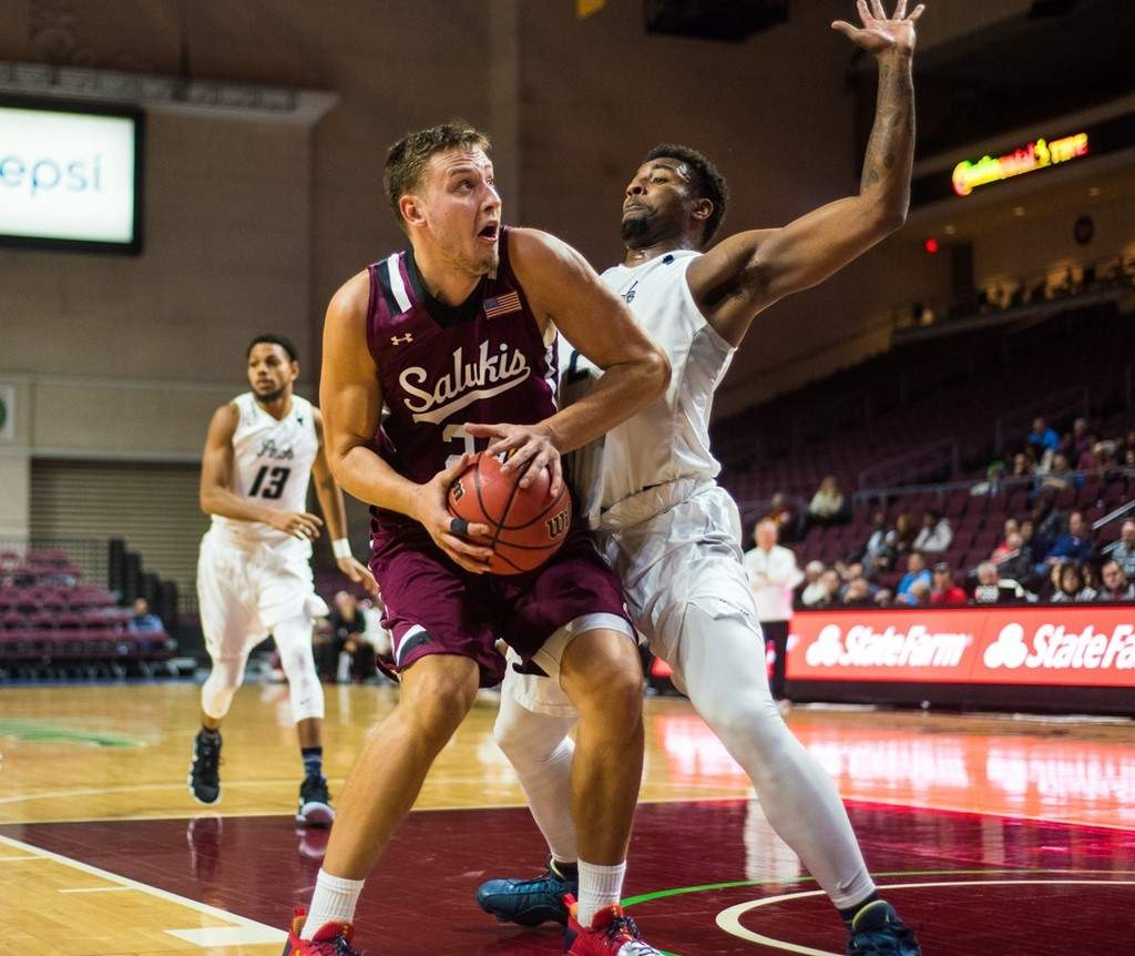 SIU forward Rudy Stradnieks attempts to find postion against a Nevada defender Friday during a 86-64 loss.