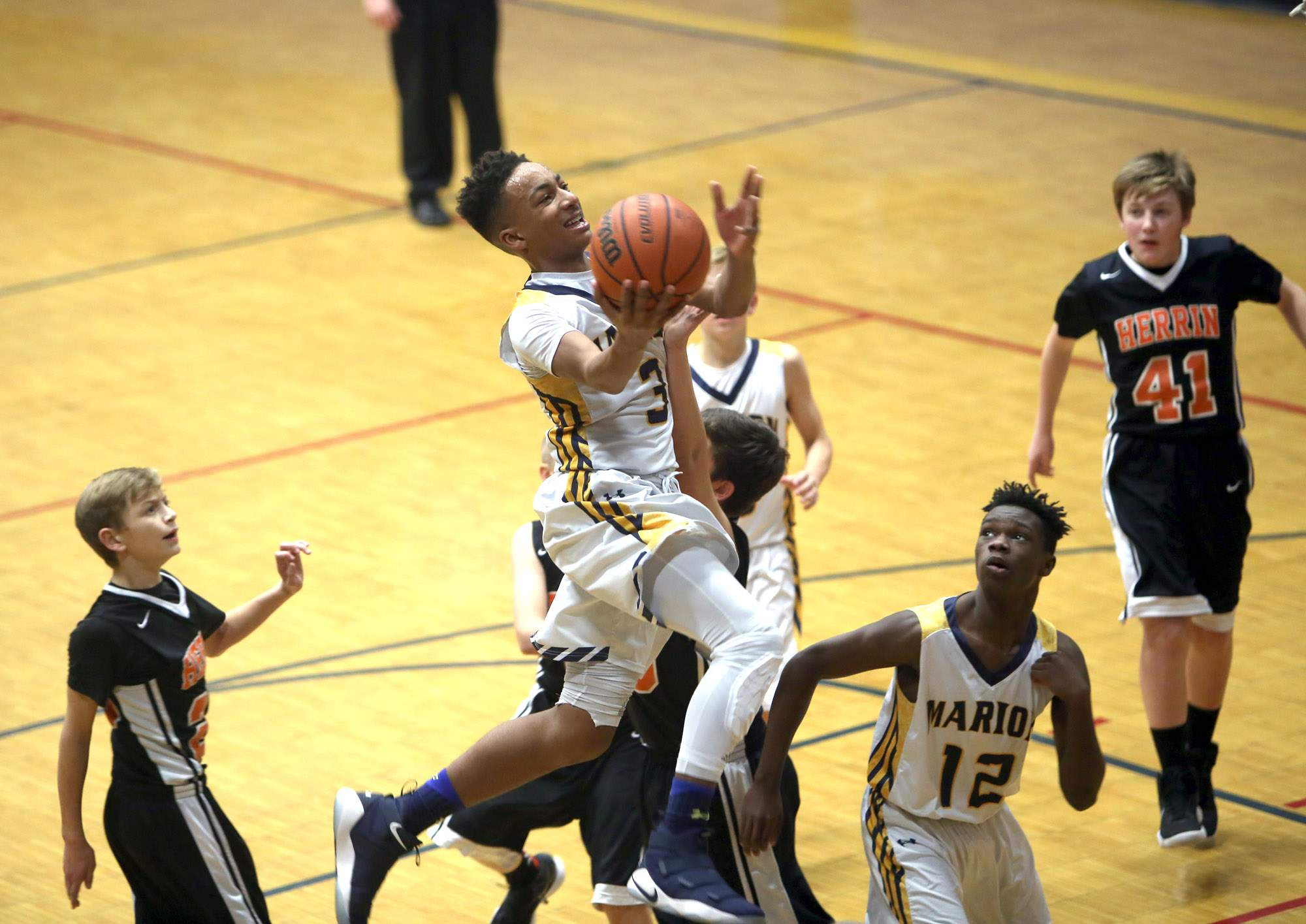 Venson Newsom attempts a layup.