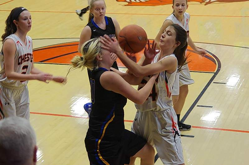 Chester High School Lady Jacket, Reese Chandler, a freshman, is mauled by Elverado Lady Falcon, Tori Ehlers (20), as she drives to the basket early in the first half of the Chester vs. Elverado 3rd Place game.