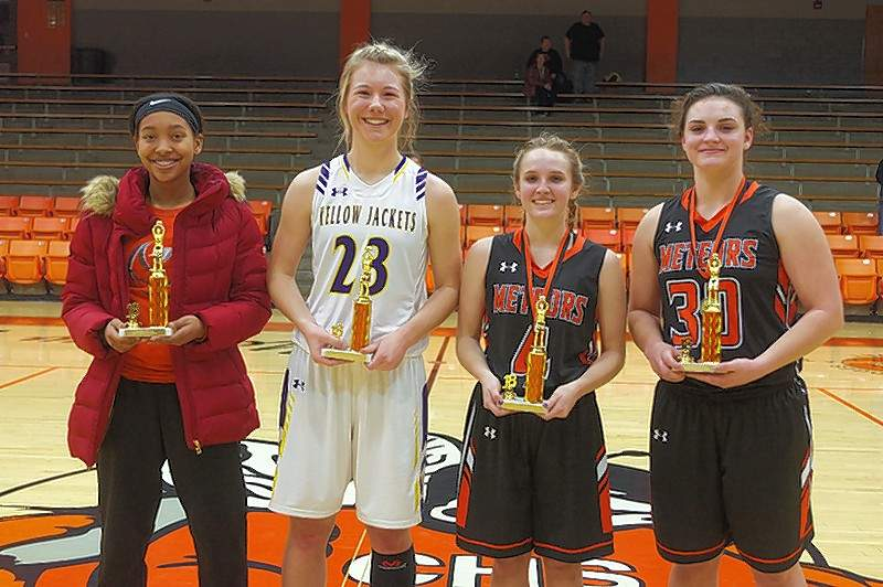 Members of the  2018 Mid-Winter Classic Basketball Tournament All-Tournament Team include, from left, Destiny Williams, Chester; Danika White, tournament MVP, New Athens; Kenzie Kern, Marissa-Coulterville; and Hailey Krause, Marissa-Coulterville. Also selected were Tori Ehlers, Elverado; Allie Whittington, Elverado; Tinleigh Jakimauskas, Valmeyer; Amiya Henry, Sparta; Reese Chandler, Chester; and Juhle Prange, Trico.