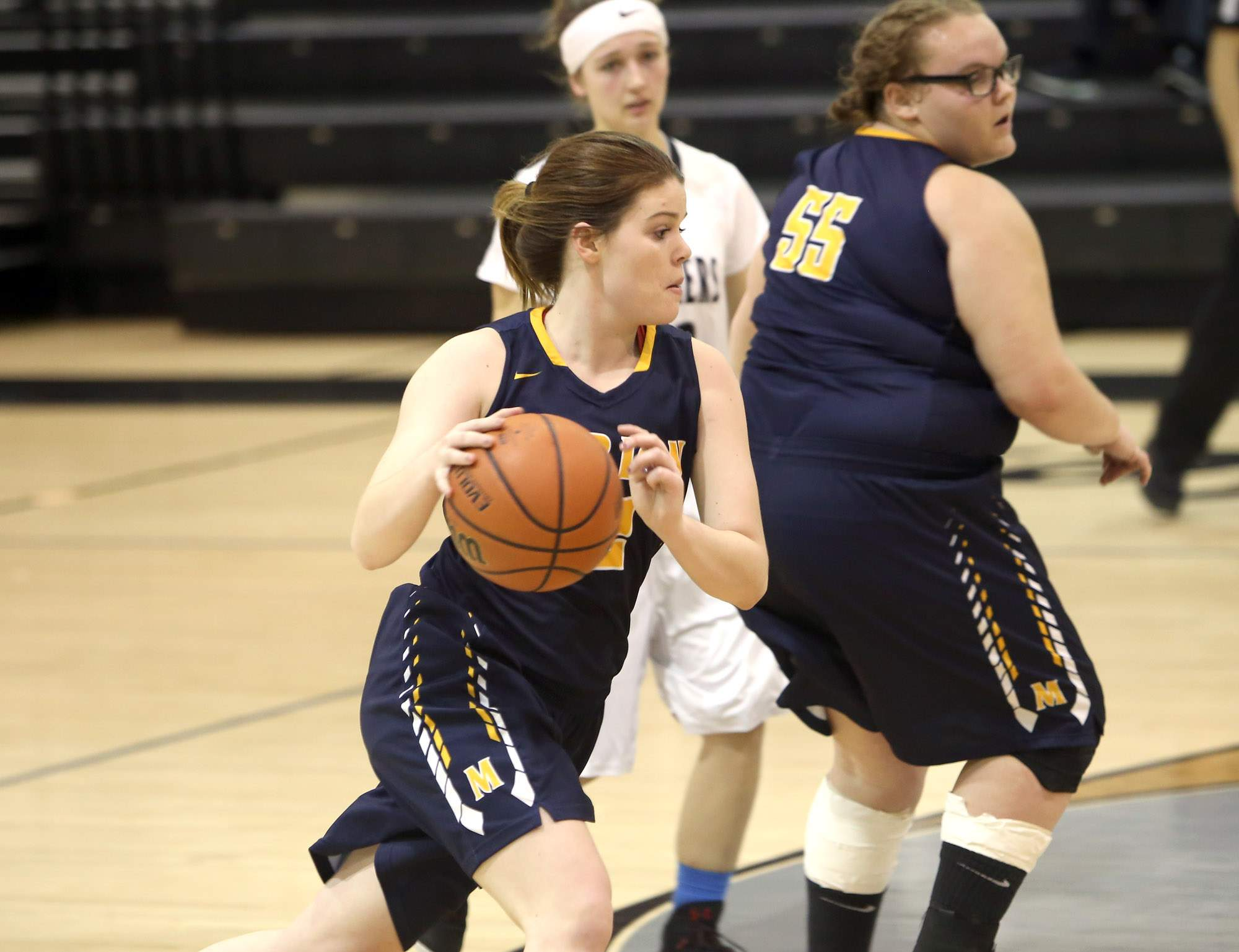 Abby Bayer drives the lane.