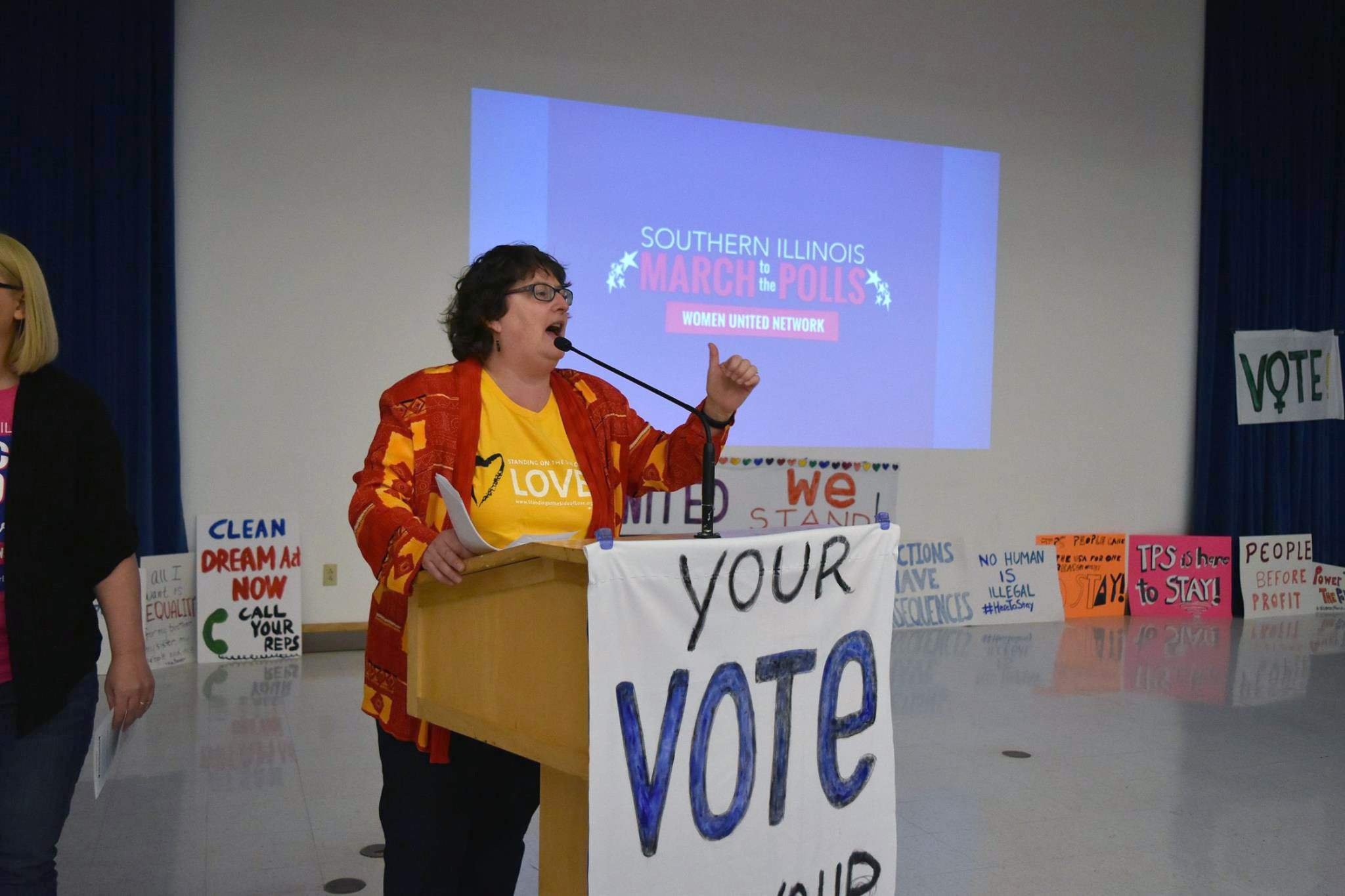 The Rev. Sarah Richards, of Carbondale Unitarian Fellowship, speaks to the crowd at the Carbondale Civic Center, the starting point for the Southern Illinois Women's March.
