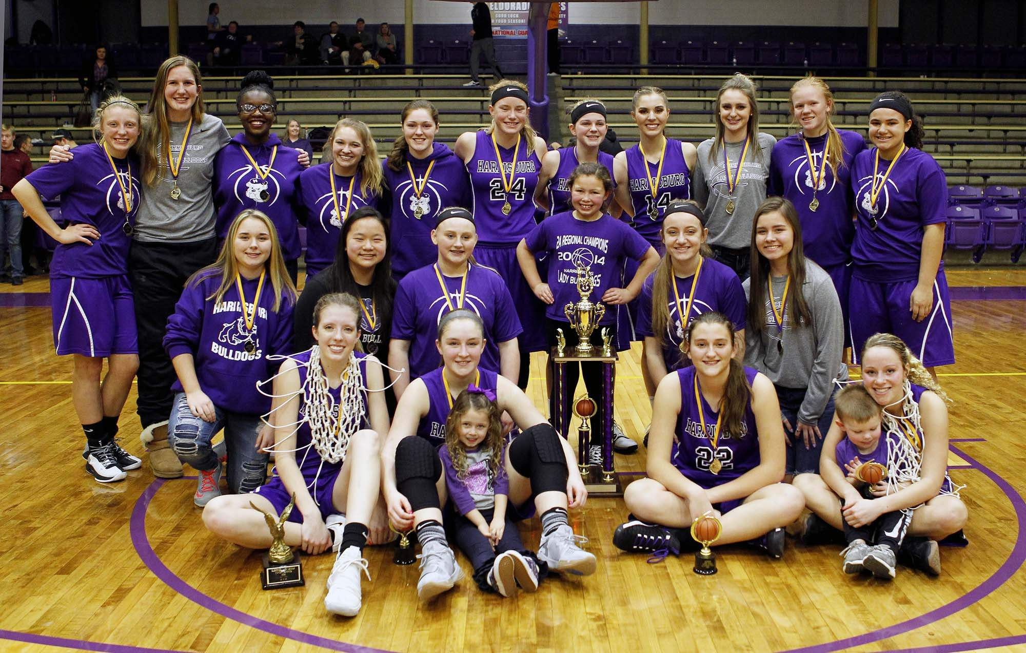 Members of the Harrisburg girls' basketball team pose with the championship trophy of the Lady Eagle Mid-Winter Classic after knocking off Mt. Carmel in the title game Saturday night.