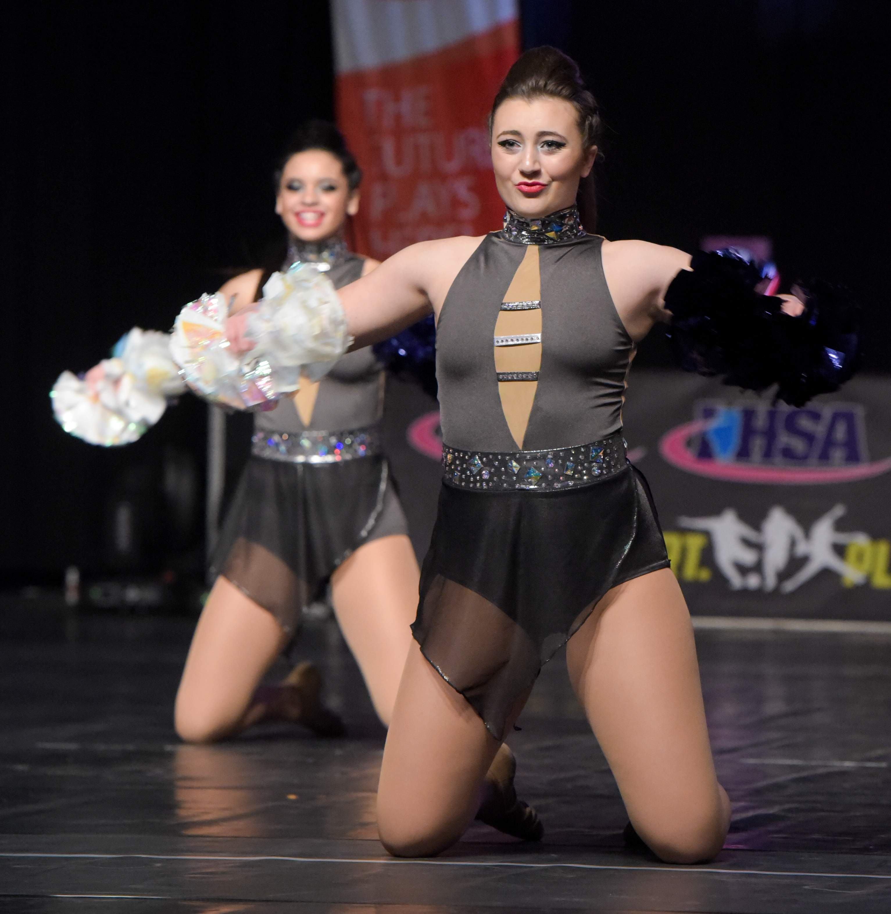 Jacey Nehring and Kylee Kerrens with the Murphysboro High School dance team, compete in Friday's state championship preliminaries in Bloomington.