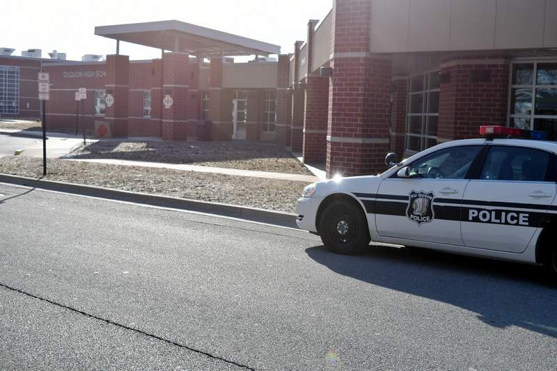 A Du Quoin Police Department squad car is shown parked outside Du Quoin High School on Monday morning. A 17-year-old DHS student was arrested Sunday in alleged connection to a social media post that referenced the Sandy Hook shooting.