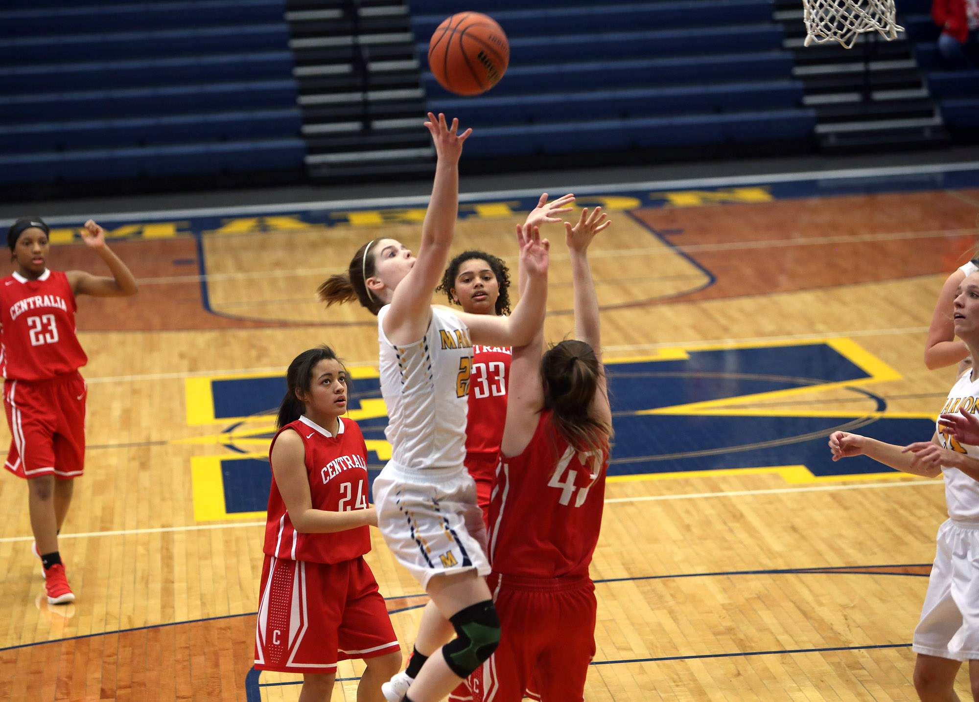 Abby Bayer goes in for a layup Monday night.