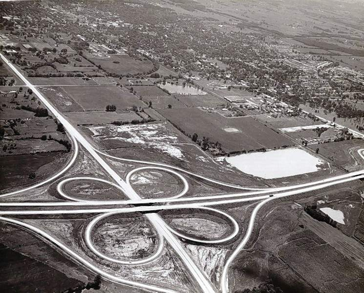 In the new I-57 clover leaf shown in 1964, note the lack of development on the east side of the interstate, where Town and Country Shopping Center is now.