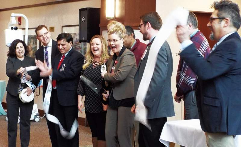 Representatives from Heartland Regional Medical Center, Cardinal Glennon Children's Hospital and the Marion Chamber of Commerce help Melissa Adkins,,CEO of Heartland Regional, as she cut the ceremonial ribbon on the telemedicine program.