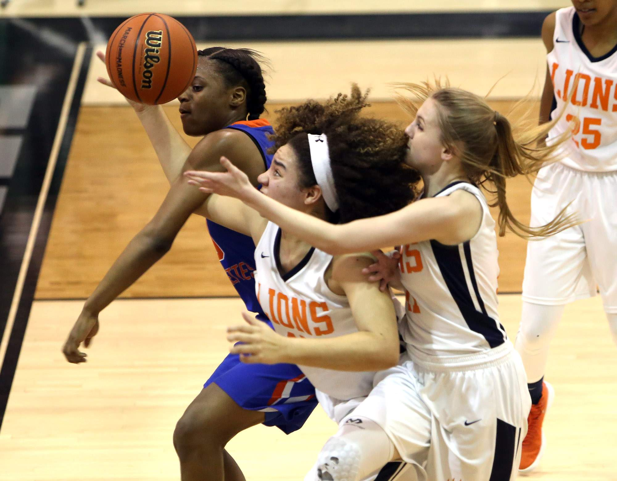 Jeniah Thompson and Lexi Swalls battle for a rebound in Tuesday's game.