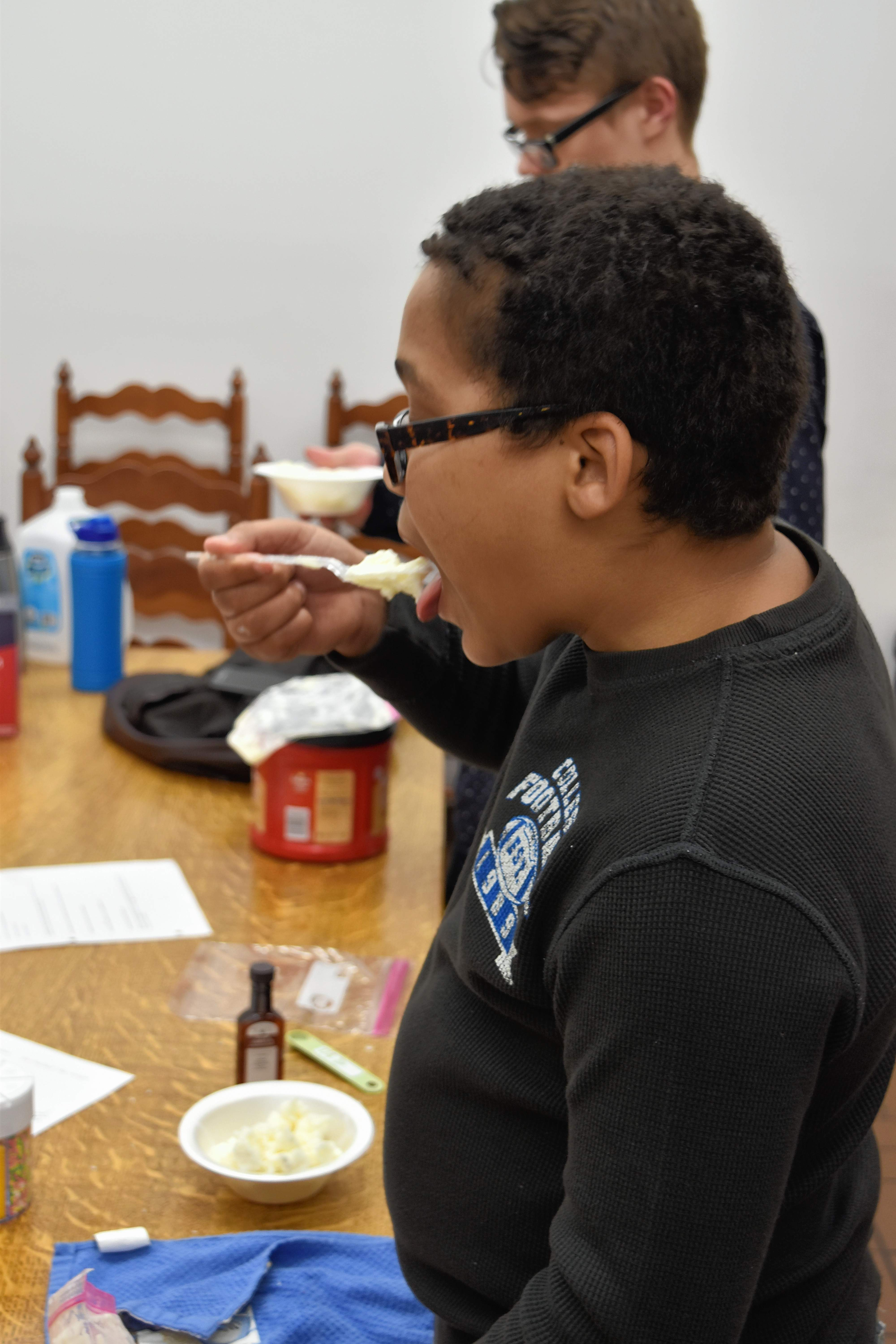 Caleb Nelson, foreground, samples vanilla ice cream he made himself. It looks pretty good!