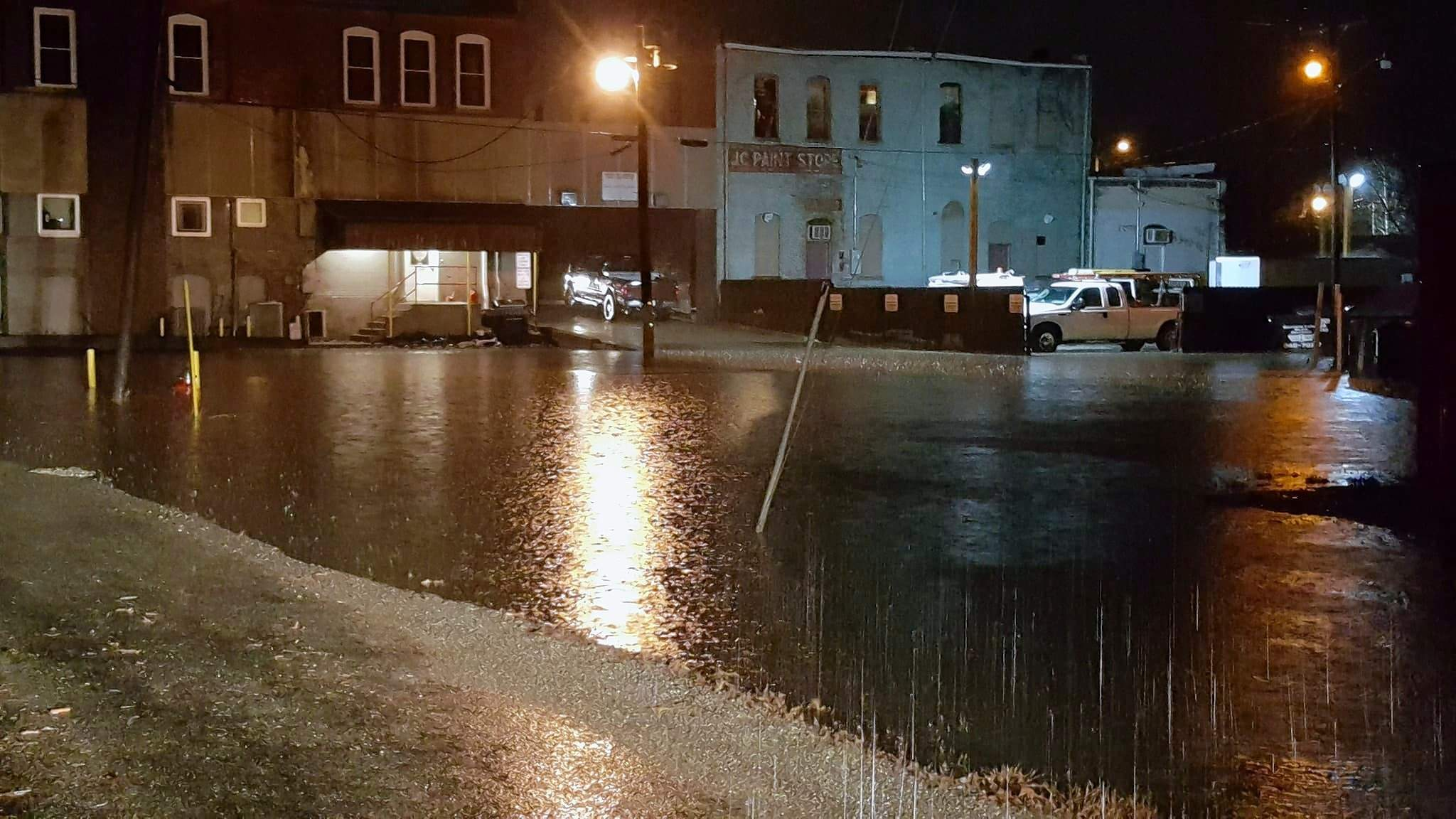 The parking area behind the Johnston City City Hall and Police Department looked more like a fishing hole as heavy rains on Saturday caused flooding.  Mayor Jim Mitchell said he had never seen that area flood.