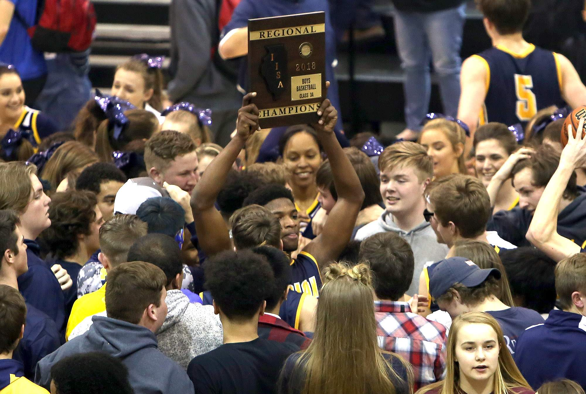 Marion senior Jaden Lacy holds up the Carbondale Regional championship plaque after Friday's win.