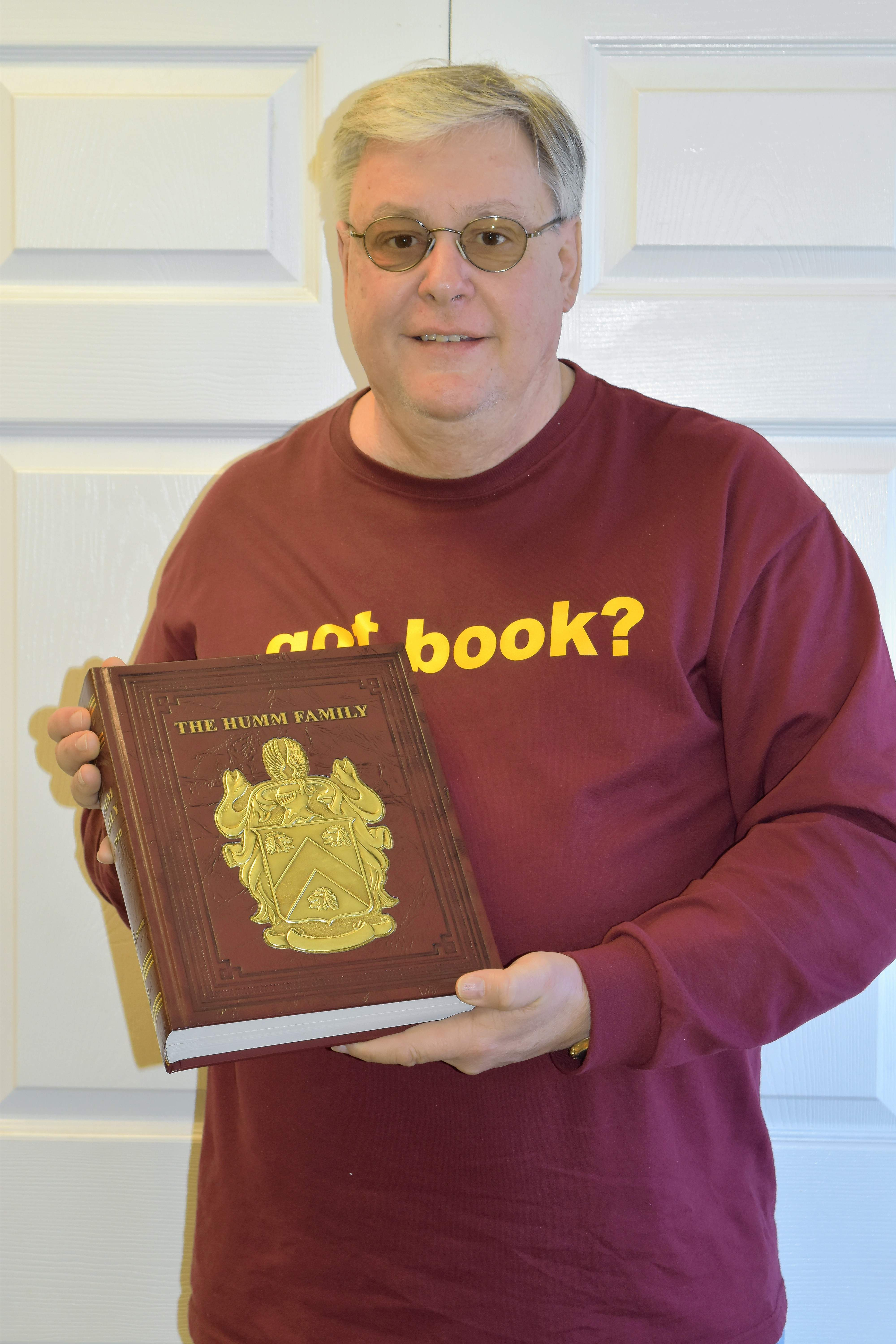 "Hardin County author Jeff Humm with a copy of ""The Humm Family."" Humm recently completed his third and final volume of his family history, ""The Humm Family Vol. III - An Addendum with Portraits from the Past."""