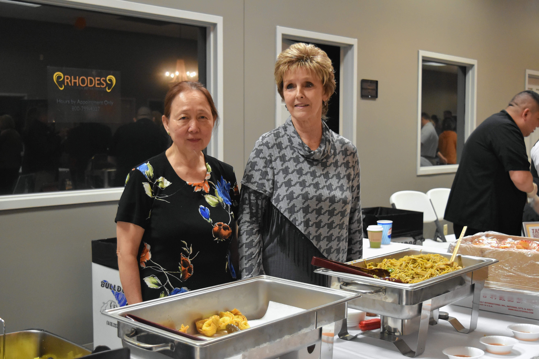 Lylen Thai and Sandie Ingram of Peking Palace in Harrisburg prepare to serve samples at Taste of Southern Illinois Sunday in Harrisburg.