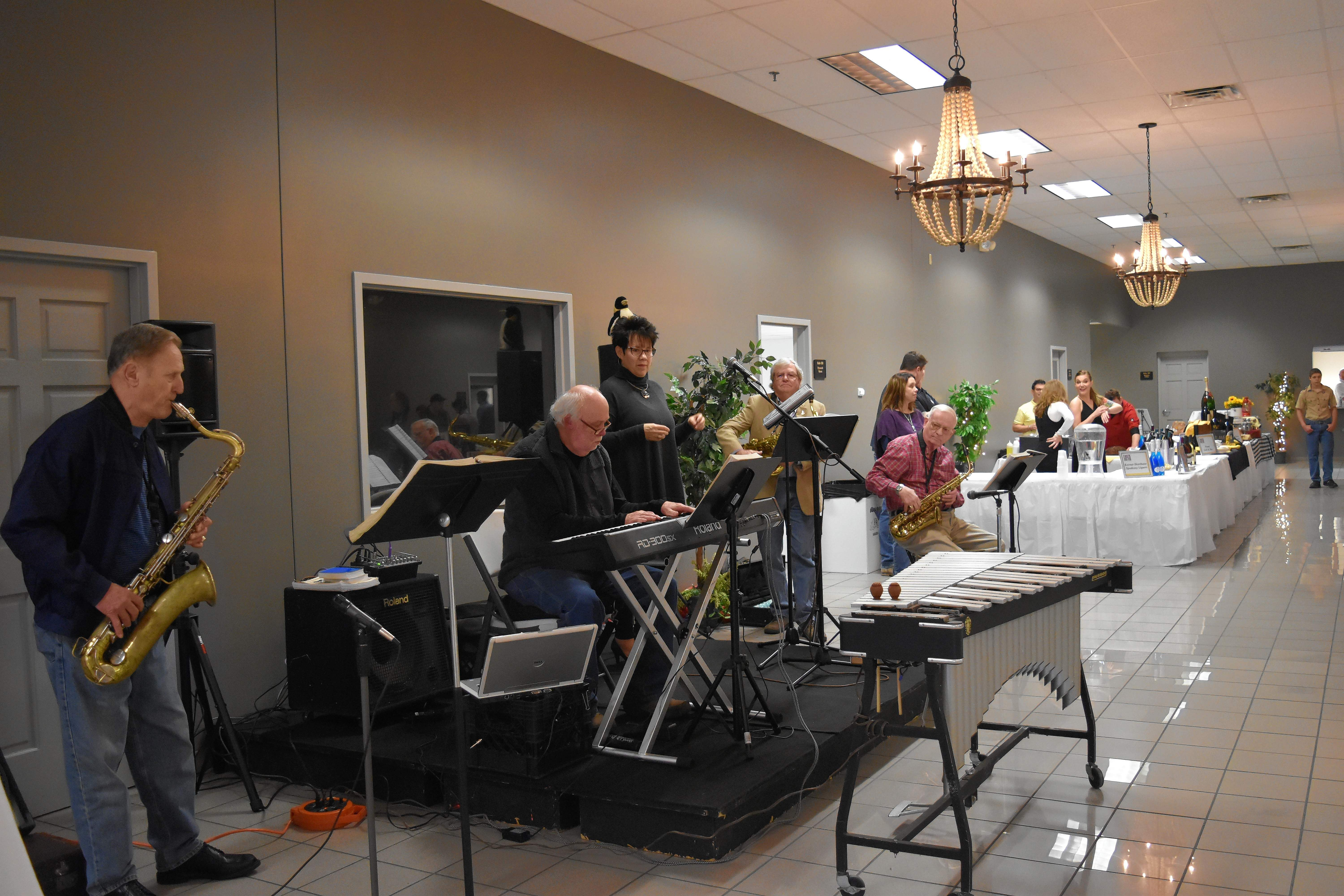 "Jazz band ""The Penguins,"" under the direction of Jim Smith on the keys, plays during the Taste of Southern Illinois Sunday in Harrisburg. The band features, from left, George Sisk, Smith, Melinda Tolley, Bruce Boone, and Greg Hodson."
