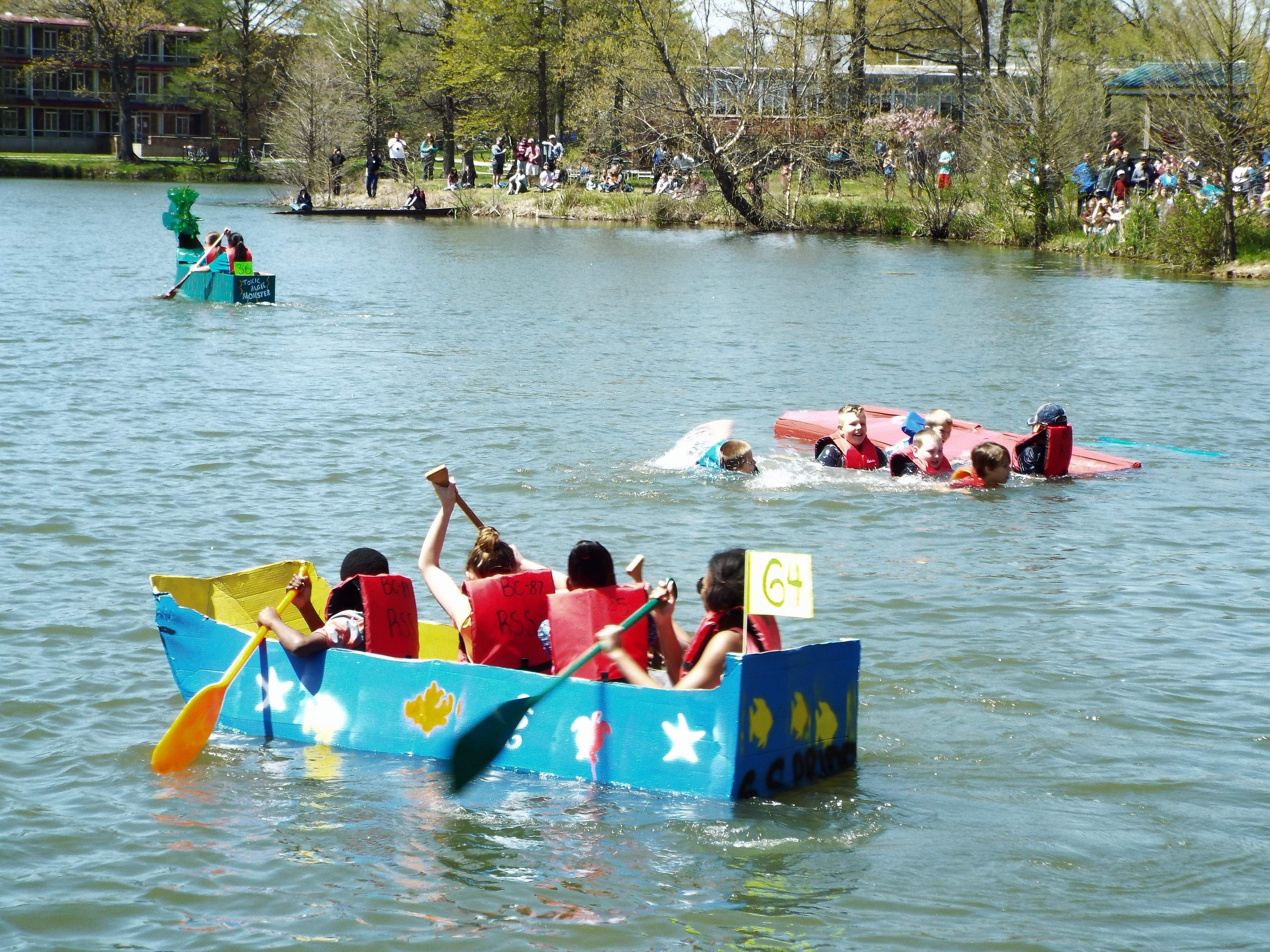 The Boys and Girls Club of Carbondale's boat was the first to sink in the first heat of the Cardboard Boat Regatta Saturday.