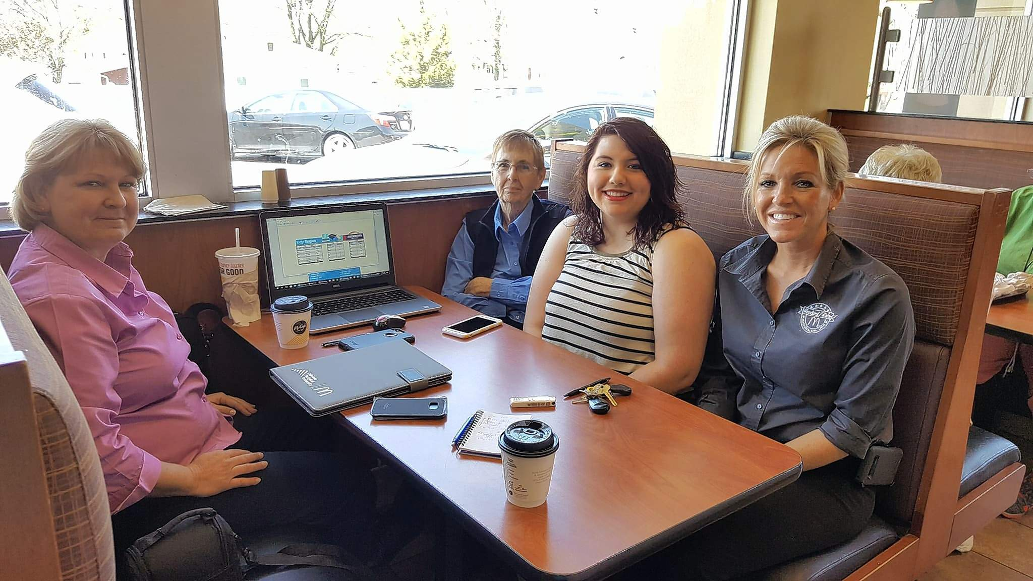 (from left) Crew Trainer Barb Mileur, Mary Moreland, Mandalin Vail, and Stephanie Bishop discuss the Archways program at the Marion Court Street McDonalds.