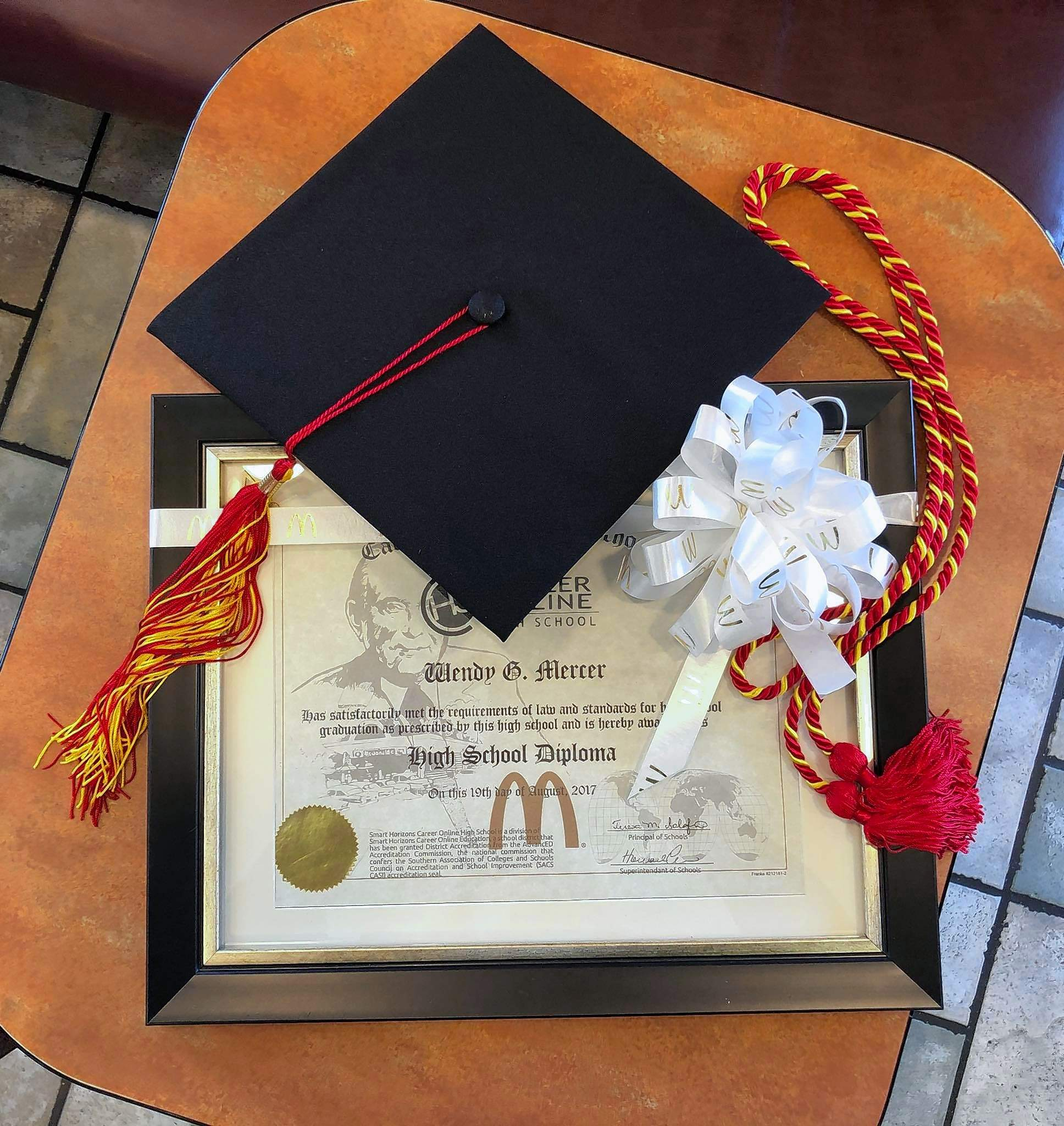 "Courtesy of Stephanie BishopWendy Mercer's diploma was cause for a celebration.  ""We make a big deal out of graduations for all of our employees,"" said Stephanie Bishop."