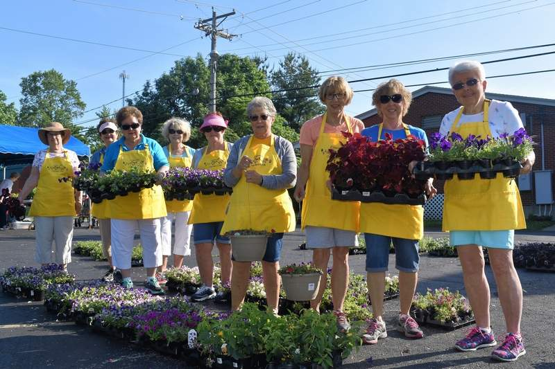 """Members of the Eldorado Garden Study Club hold a variety of flowers for sale at their annual """"Truckload Plant Sale"""" Wednesday."""