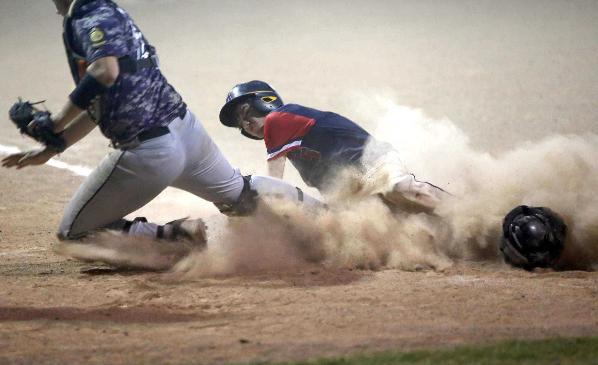 Brendan Soldner slides into home plate with the winning run in the ninth inning Monday night.
