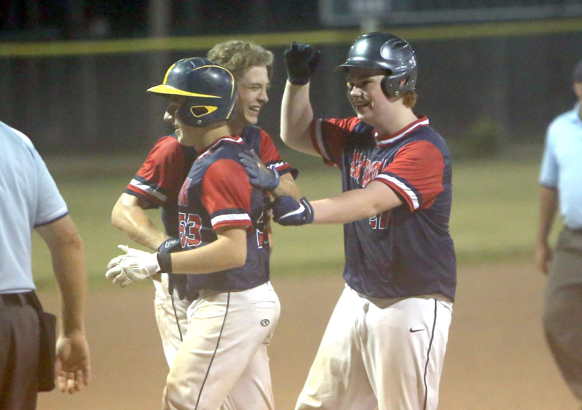 Aaron Maragni is congratulated after driving in the winning run.