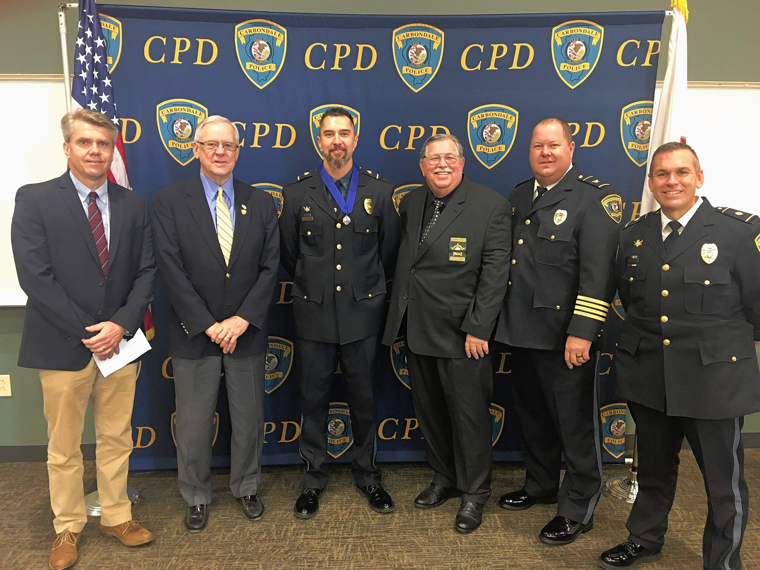 From left, Carbondale City Manager Gary Williams, Mayor Mike Henry, Sgt. Guy Draper, FOP awards chair Jerry Lieb, Police Chief Jeff Grubbs and Deputy Chief Stan Reno.