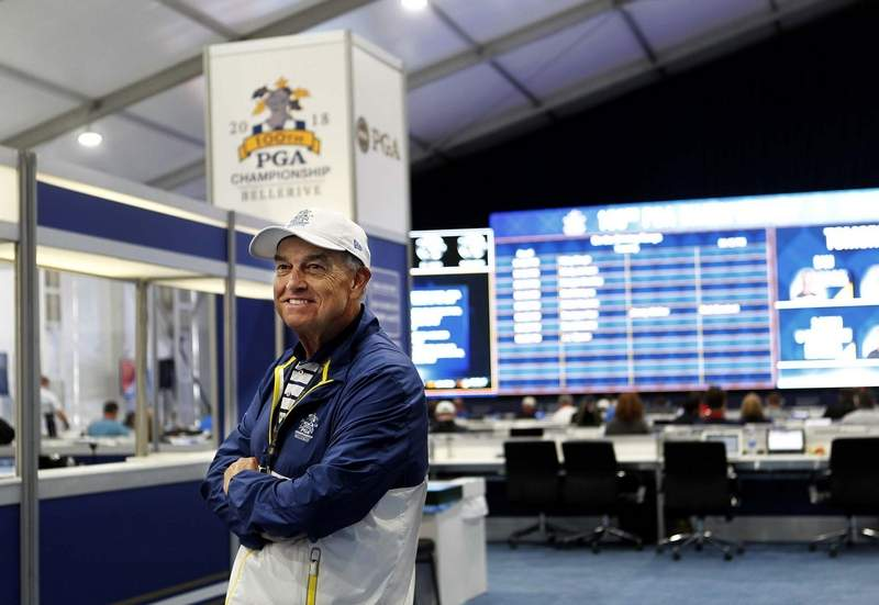 Harrisburg native Steve Burns smiles as he assists media covering the 100th PGA Championship at Bel- lerive Golf Club in St. Louis. Burns, who now resides in Eurkea, Mo., is one of 4,200 volunteers helping out this week.