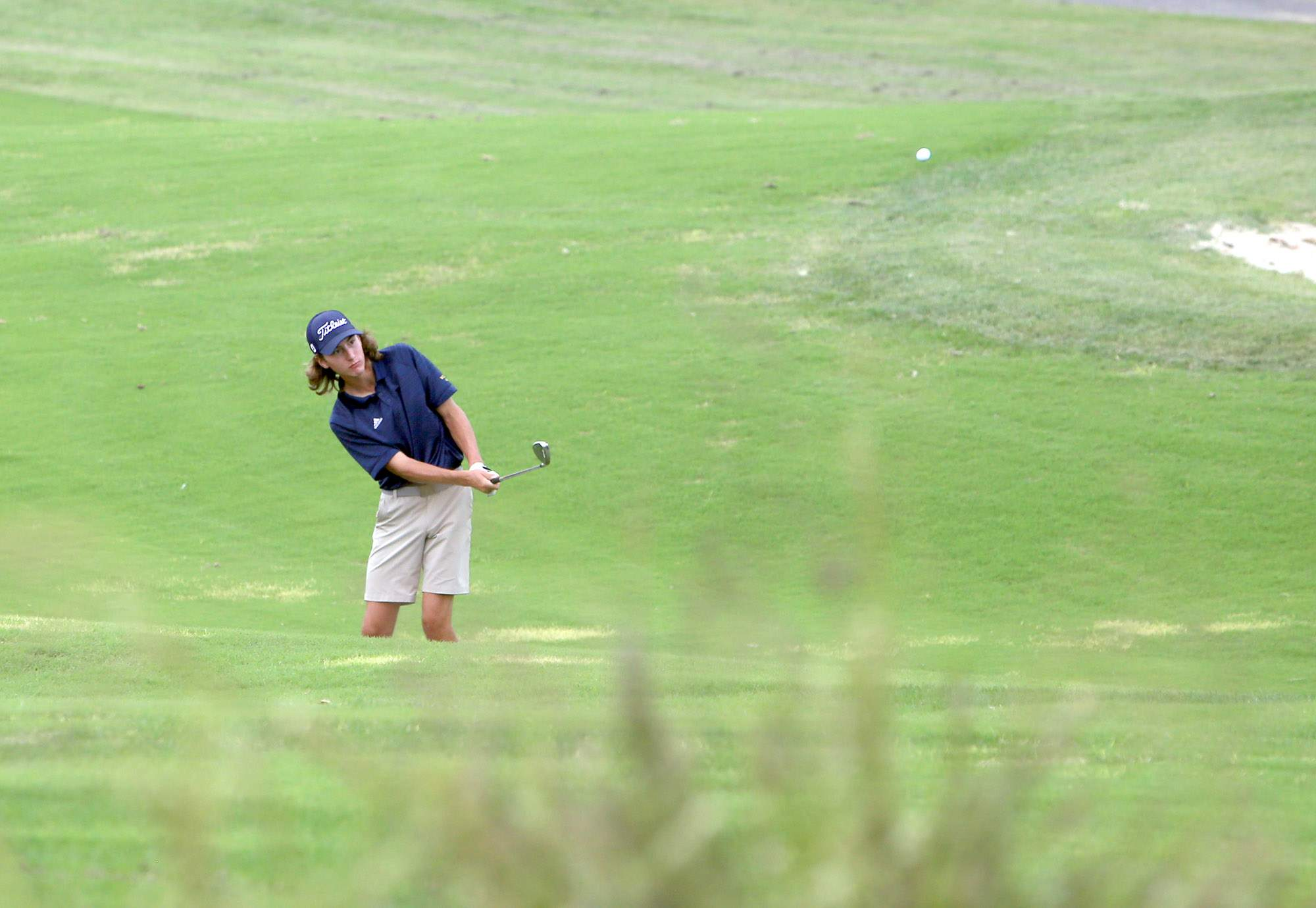 Marion's Cooper Smith hits a chip shot during the Marion Invitational on Wednesday at Kokopelli.