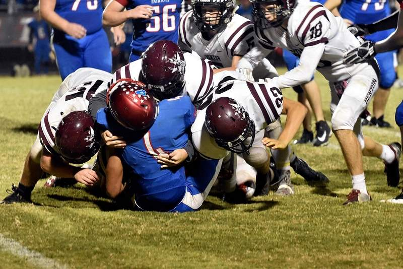 Defense: Benton's defense was stingy on Friday night. Here a host of Benton defenders, including Andrew Dunn (15), Jadon Stark (22) and Brendan Minor (32) all pile up on Massac County's David Thompson for a loss. The Patriots had just 19 rushing yards in the game.