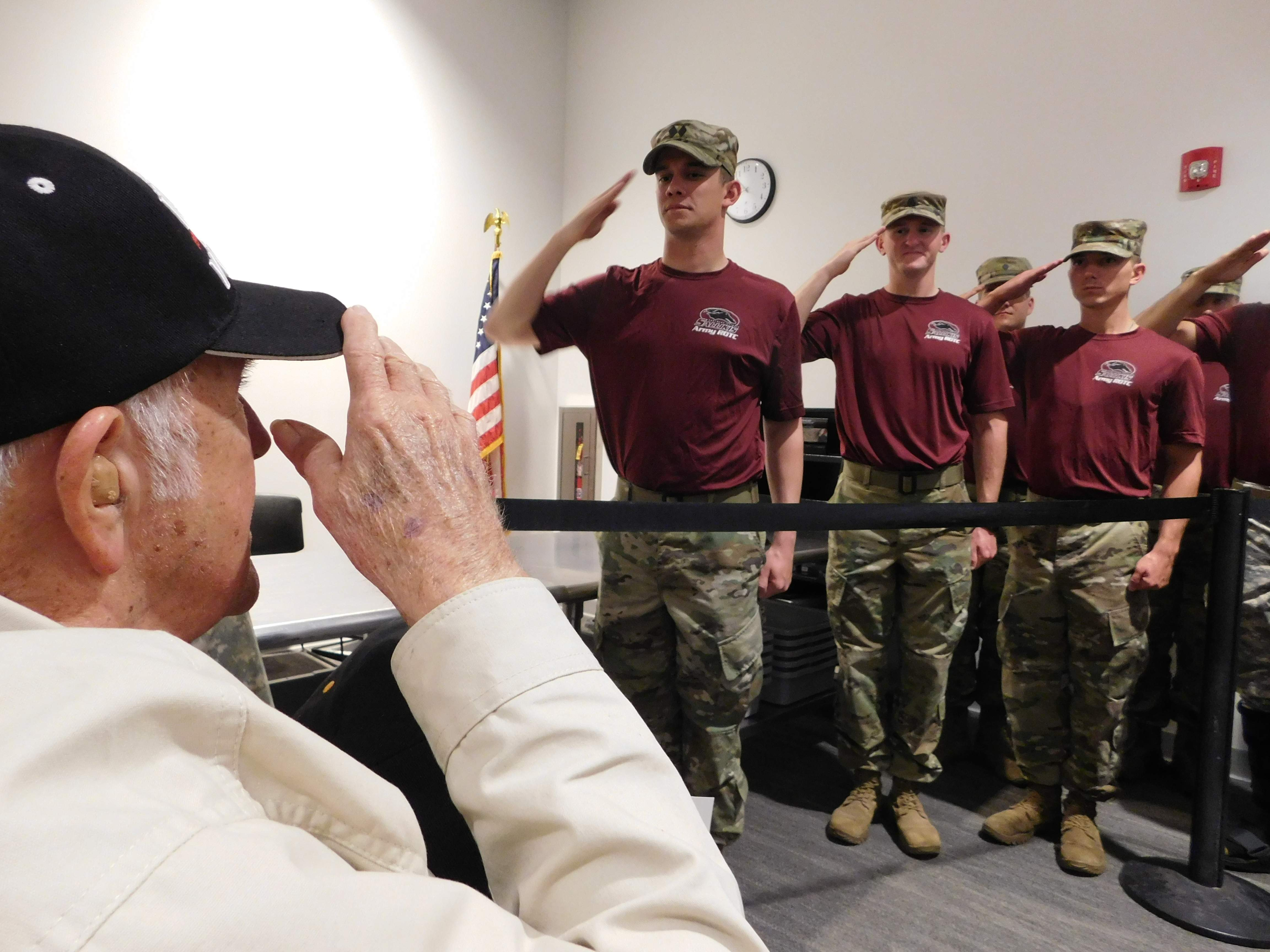 William Thomas of Benton returned the salute to members of SIU's ROTC as he made his way through the crowd upon returning from his day in Washington, D.C. on the April 2017 Honor Flight.