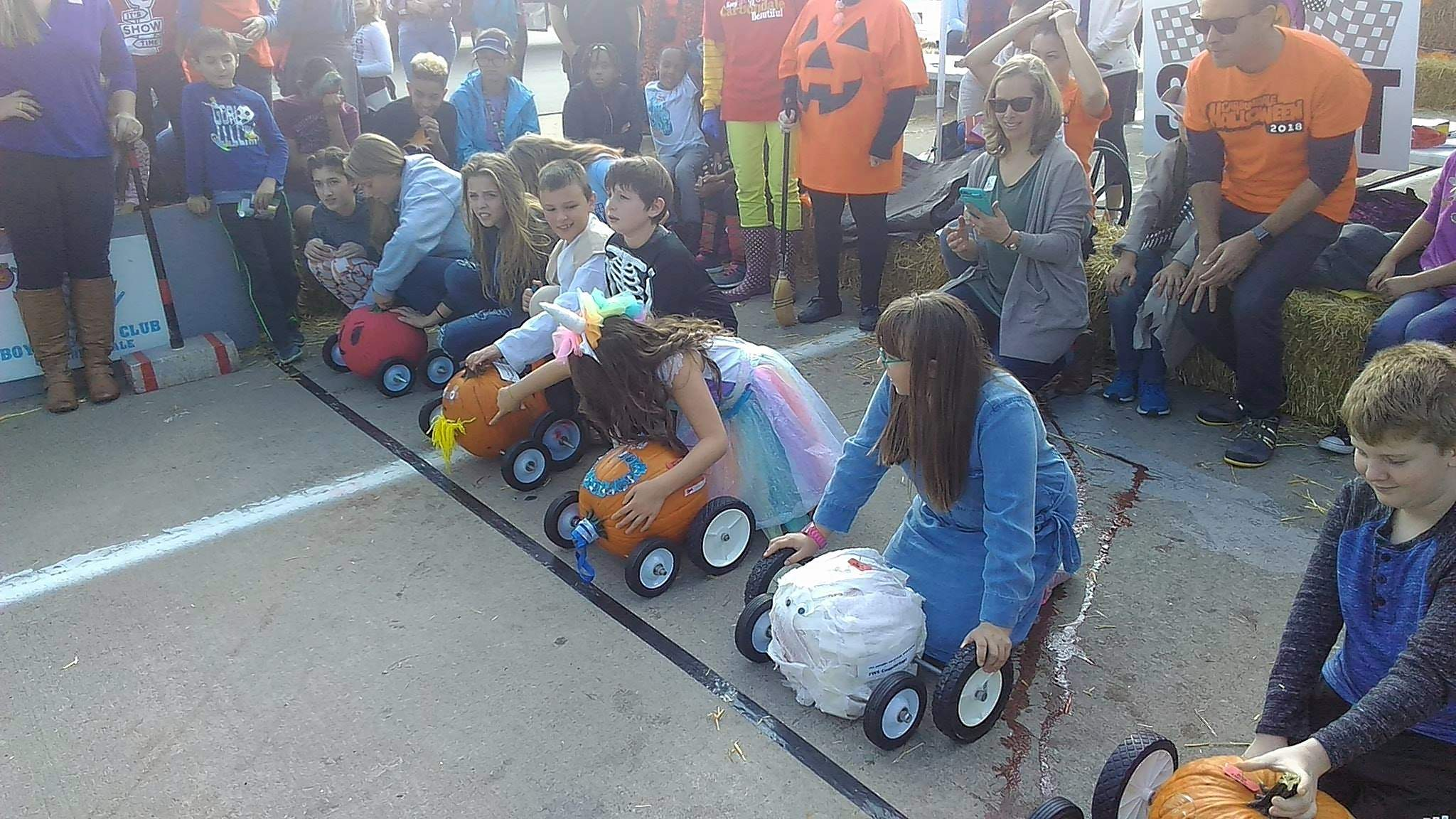 Racers wait at the starting line of Saturday's pumpkin races at the Mill Street Underpass.