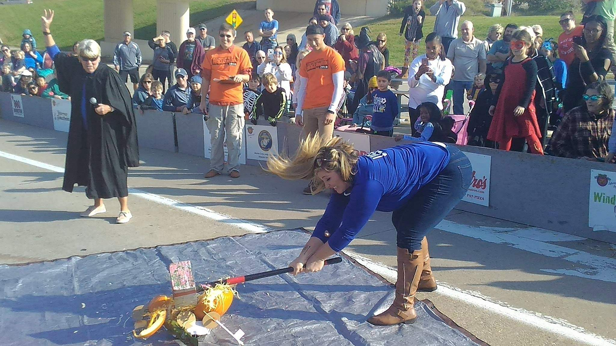 Past SIU and Olympic thrower DeAnna Price was the smasher of pumpkins at Saturday's races.