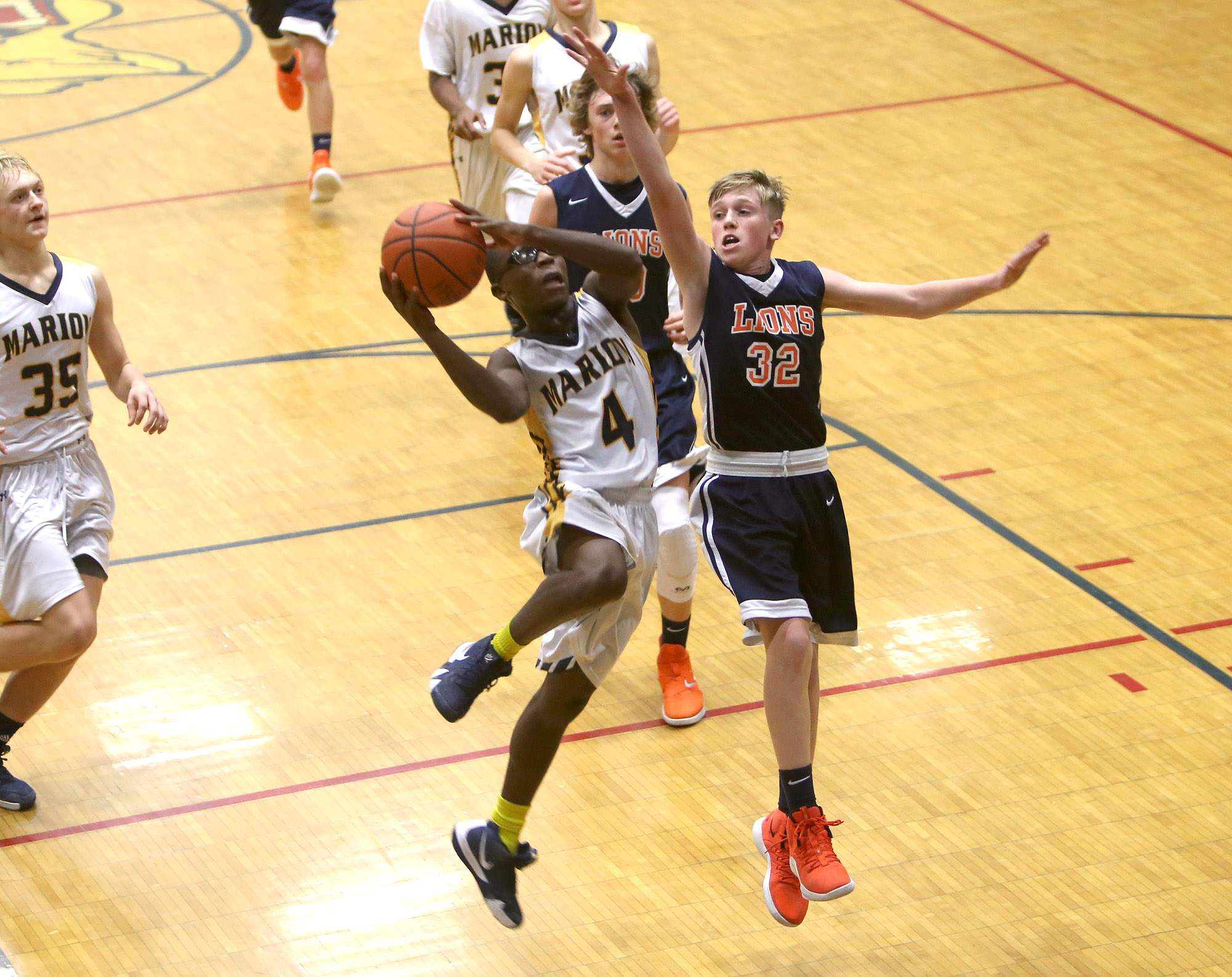 Benja Stone attempts a layup Tuesday night against Carterville.