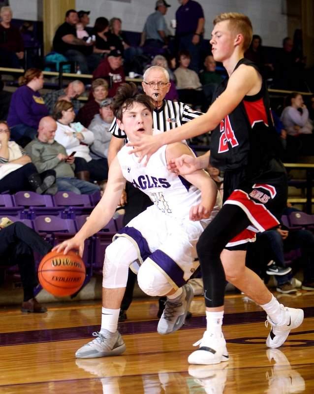 Eldorado's Bryant Byrd looks for room to maneuver around the defense being applied by Fairfield's Landon Zurliene in the first half Friday night at Duff-Kingston Gymnasium.