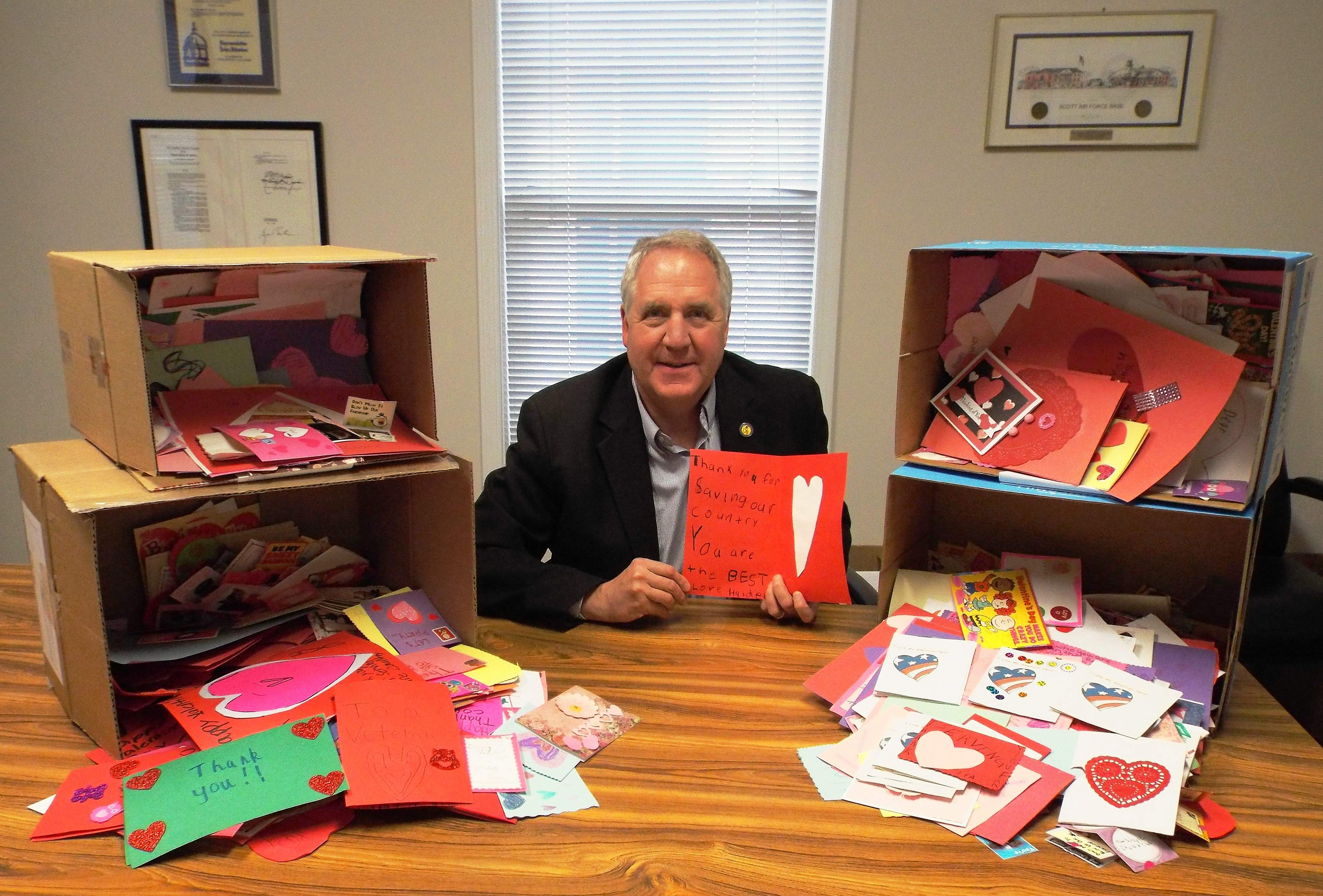 Congressman John Shimkus, R-Collinsville, shows off some of the valentines that were mailed in to veterans last year by residents of his district.
