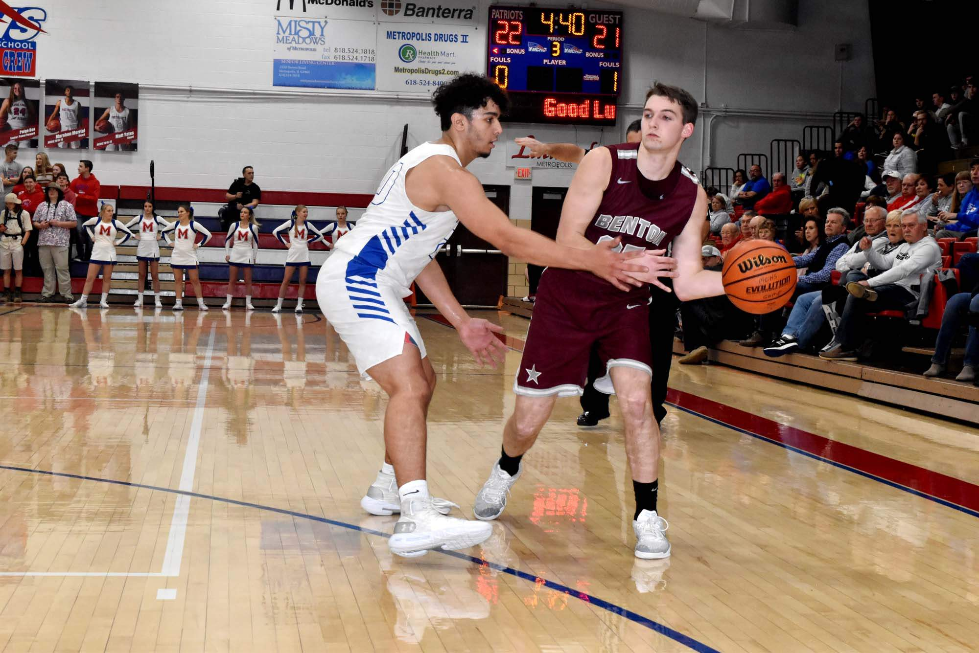 Benton High School's Mason Wills makes a pass to a teammate on the baseline during the Rangers' game against Massac County on Friday night. Wills hit 3-of-4 free throws in the final two minutes of the game to seal the victory.