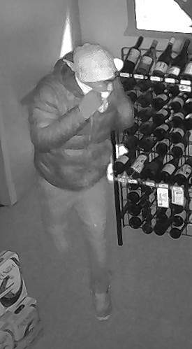 Police are seeking information on two suspects wanted in connection with a Dec. 25 burglary at Illinois Liquor Mart.